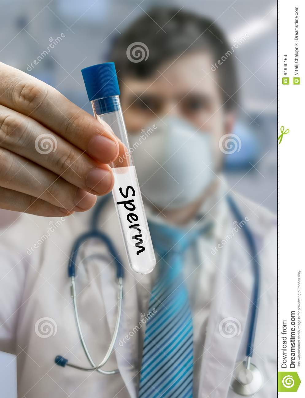Embryologist doctor in sperm bank holds test tube with sperm sam
