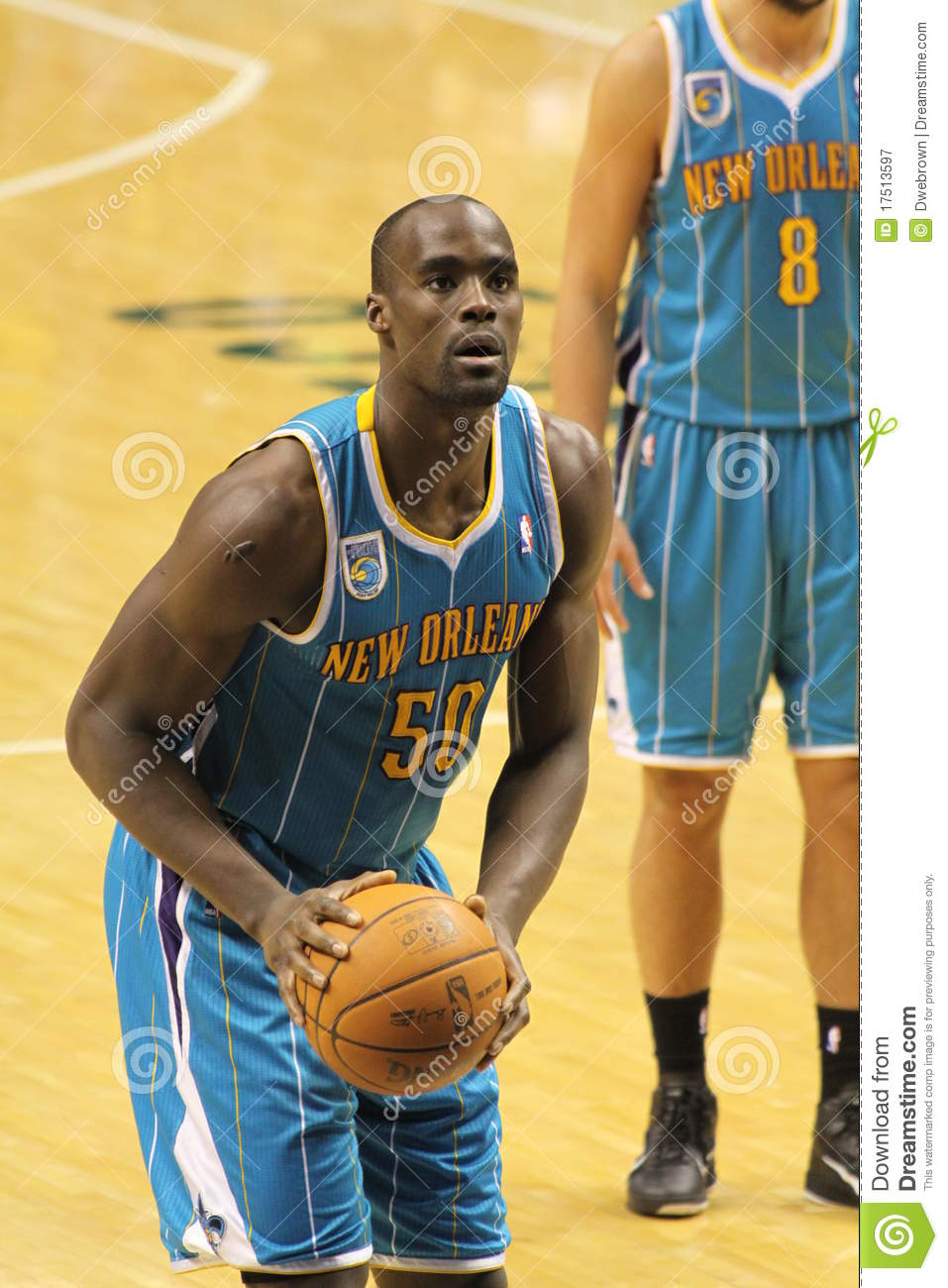 86d656f3 Emeka Okafor is attempting a free throw for the New Orleans Hornets during the  second half of action. New Orleans Hornets vs. Indiana Pacers at Conseco ...