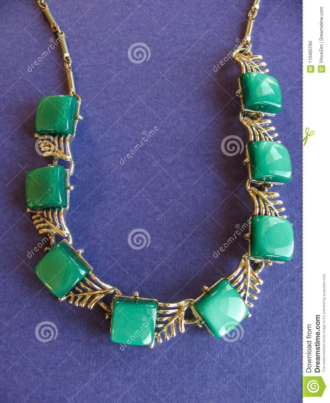 Emerald Green Vintage Necklace Of Lucite Squares Linked By A Gold Tone Chain On Rich Purple Background