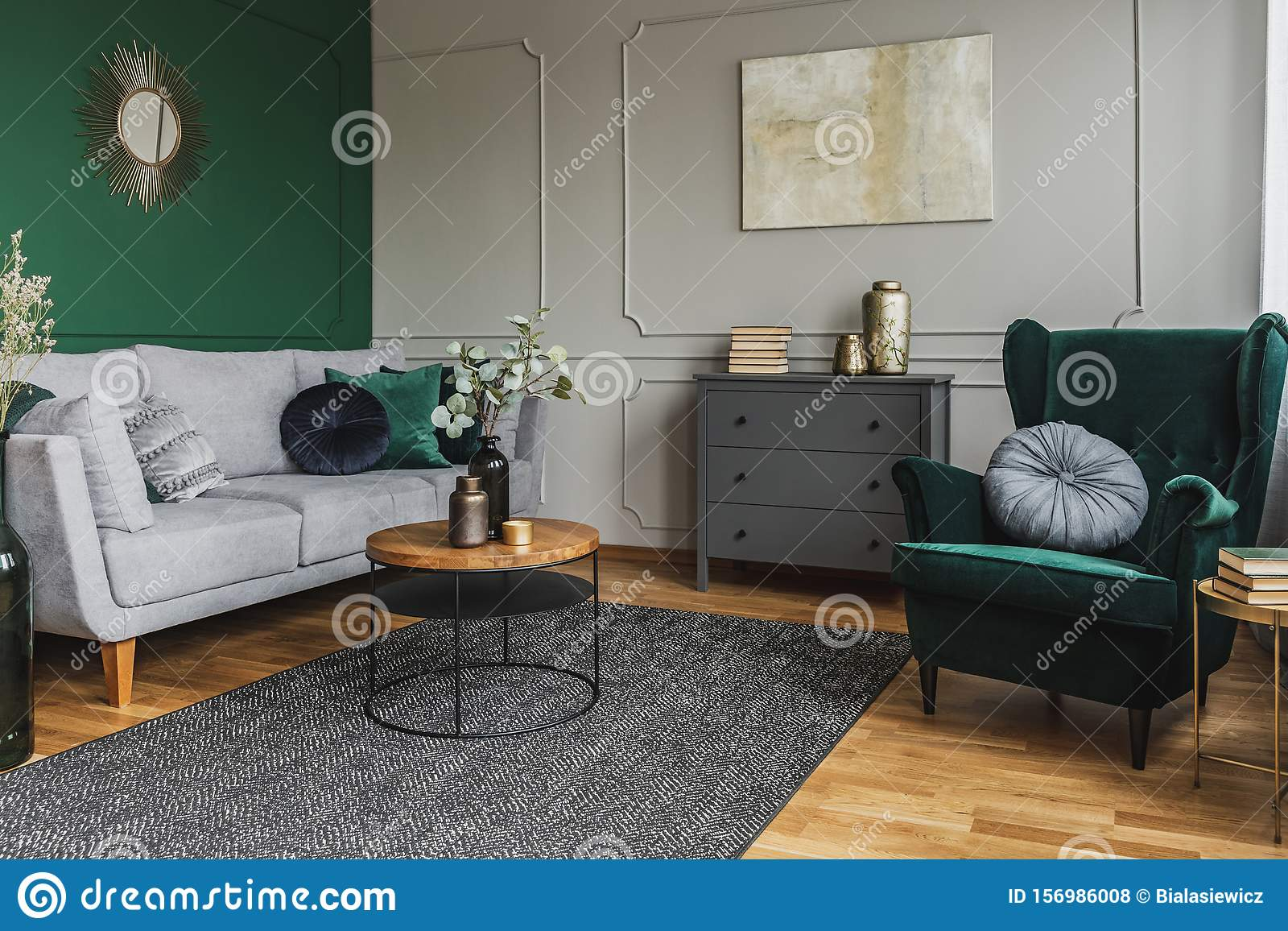 Emerald Green Wing Back Chair With Pillow In Grey Living Room Interior With Wooden Commode Stock Photo Image Of Bright Comfortable 156986008