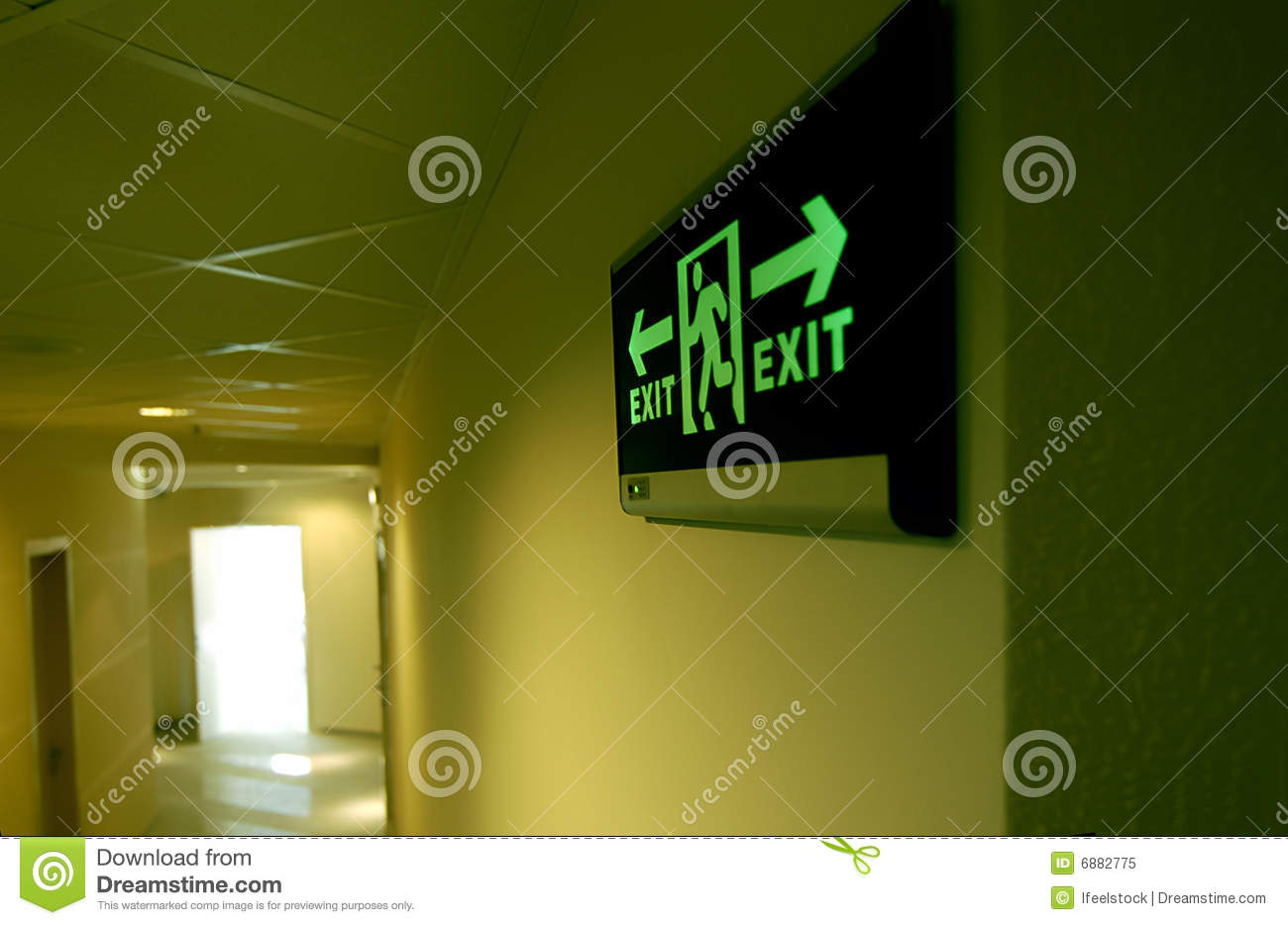 Emergency Exit Sign In A Building Glowing Green Royalty