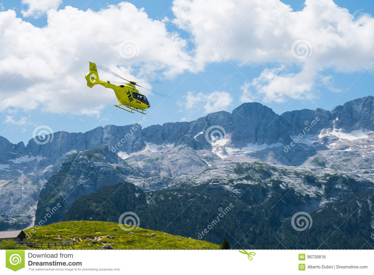 Emergency helicopter hovering over the mountains