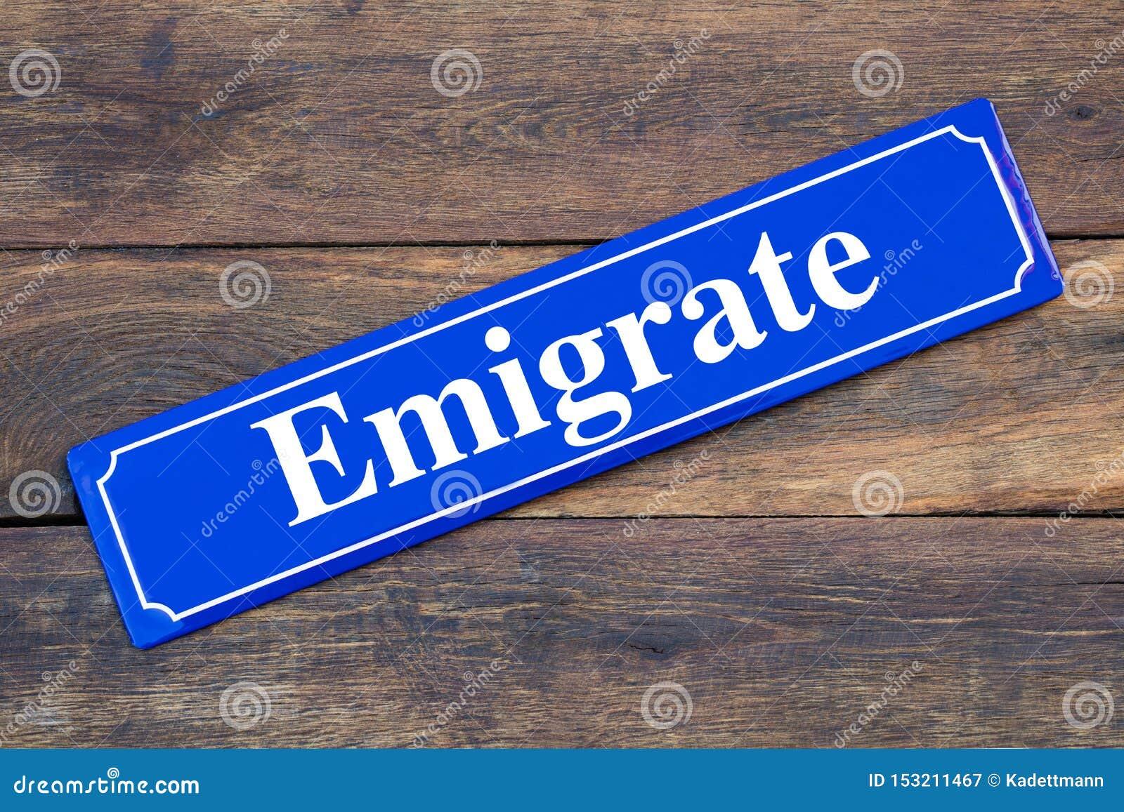Emigrate street sign on wooden background