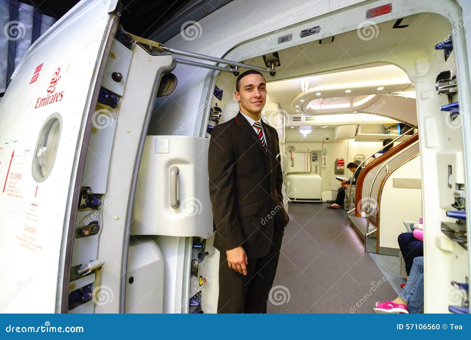 Emirates crew member meet passengers