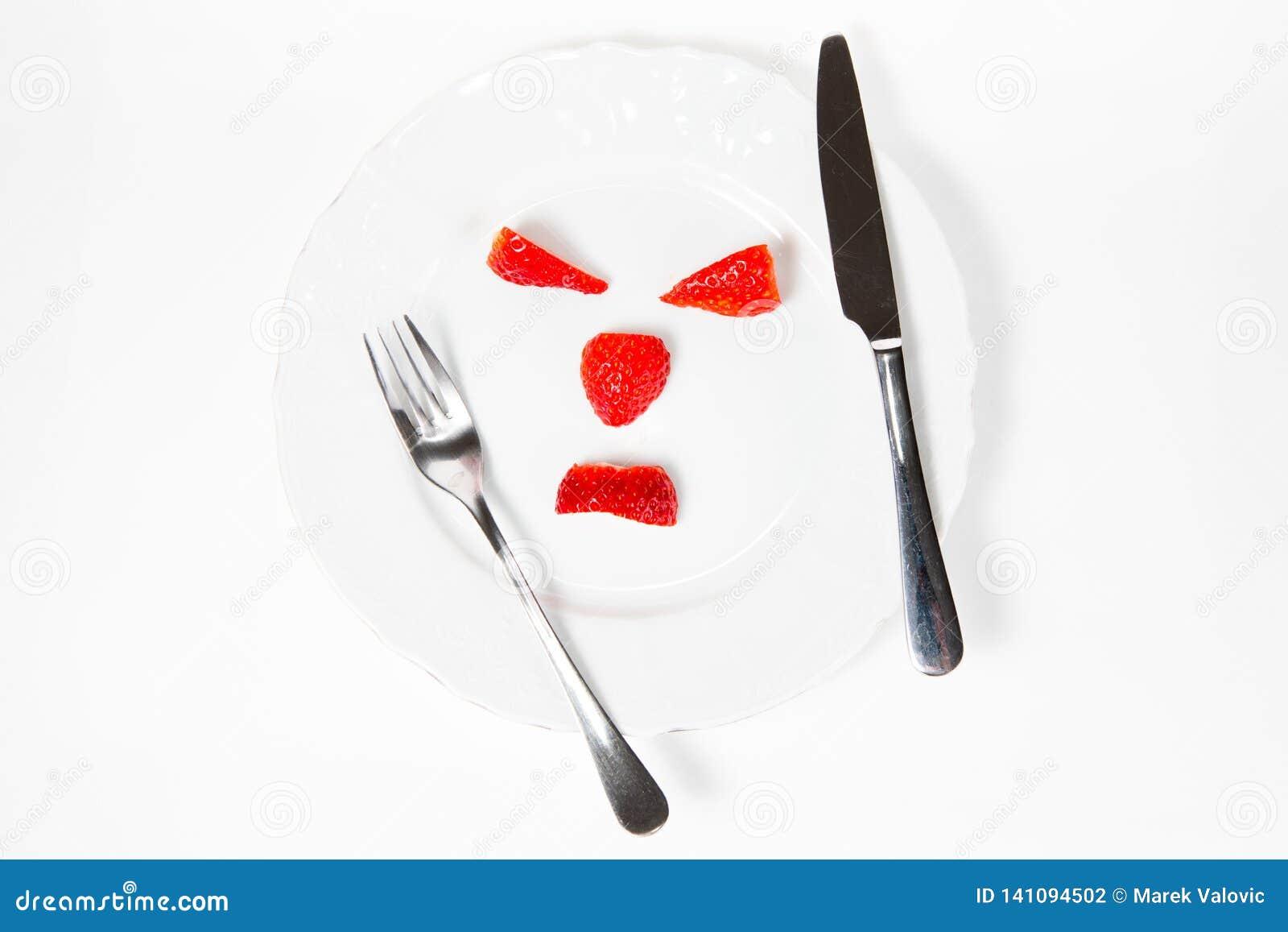 Emoticonen gör från jordgubbar som säger - meningen din kroppsvikt