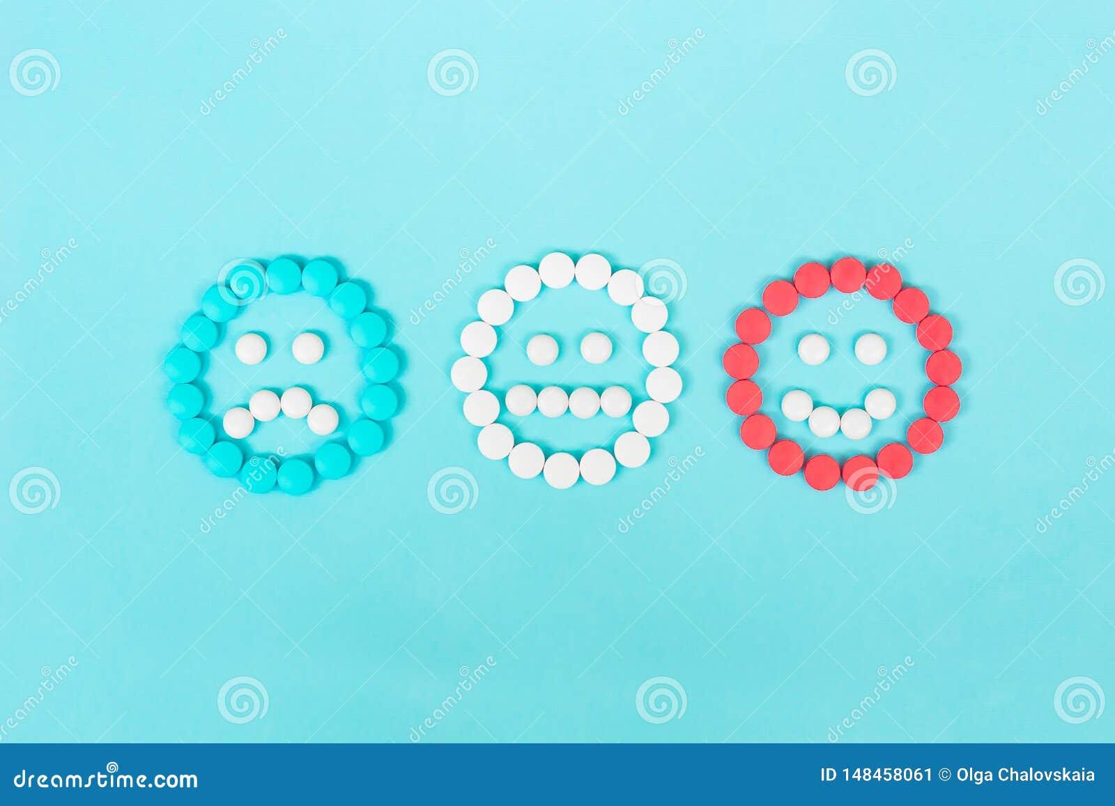 Emoticons das tabuletas da medicina Tratamento do conceito da depressão e da neurose Comprimidos azuis, brancos e vermelhos