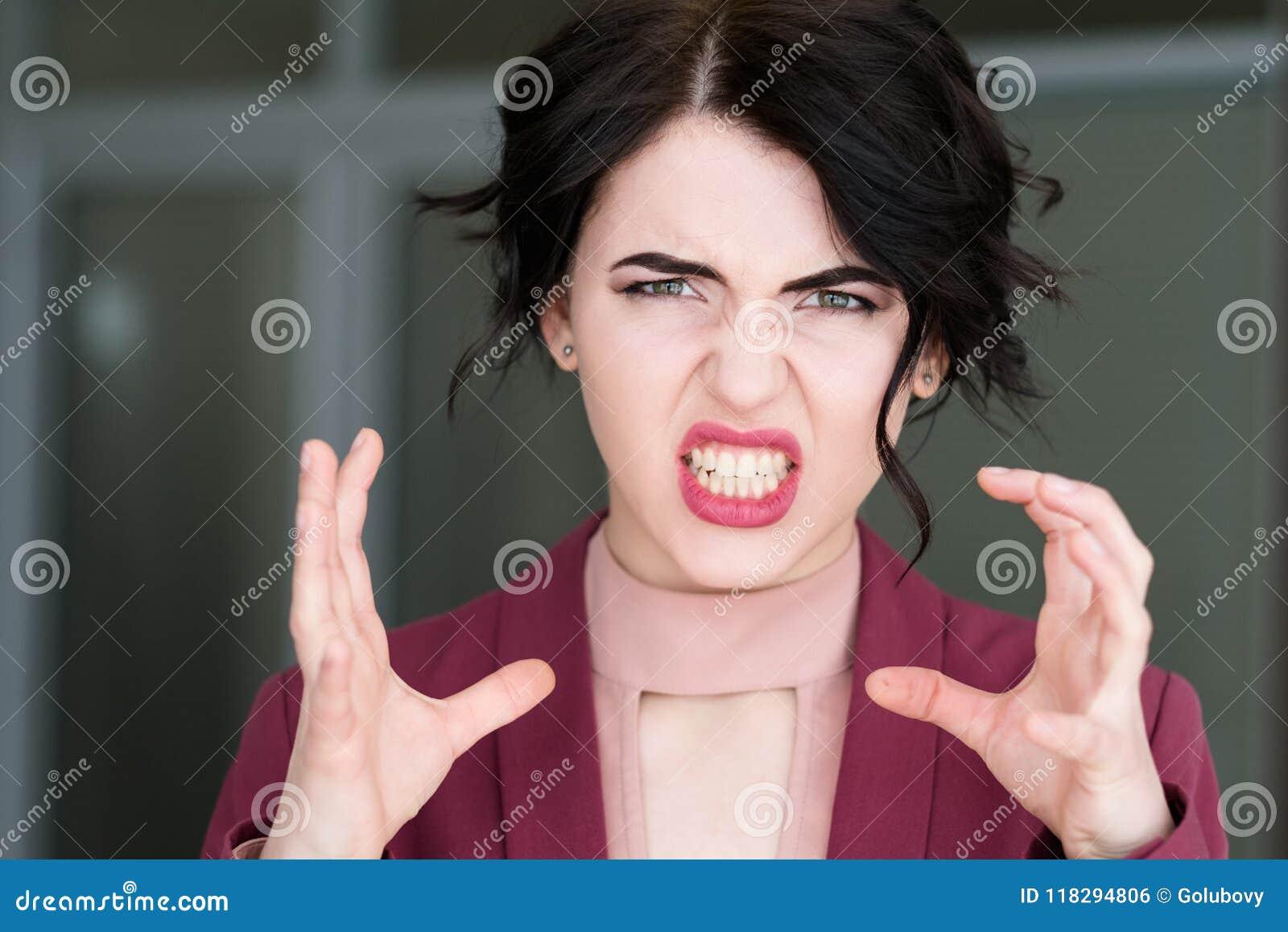 Emotion face rage fury strangle woman baring teeth