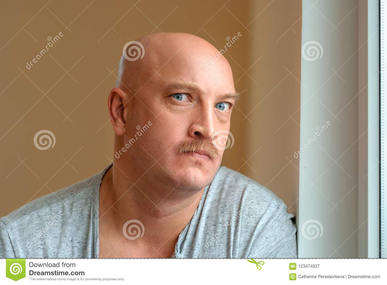An emotional man with a mustache different facial expressions on the face