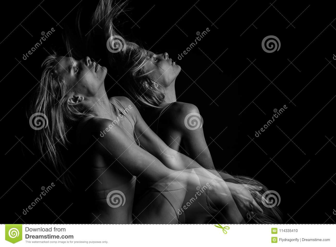 Emotional portrait of young blonde woman with fying hair. Black and white photo. triple exposure.