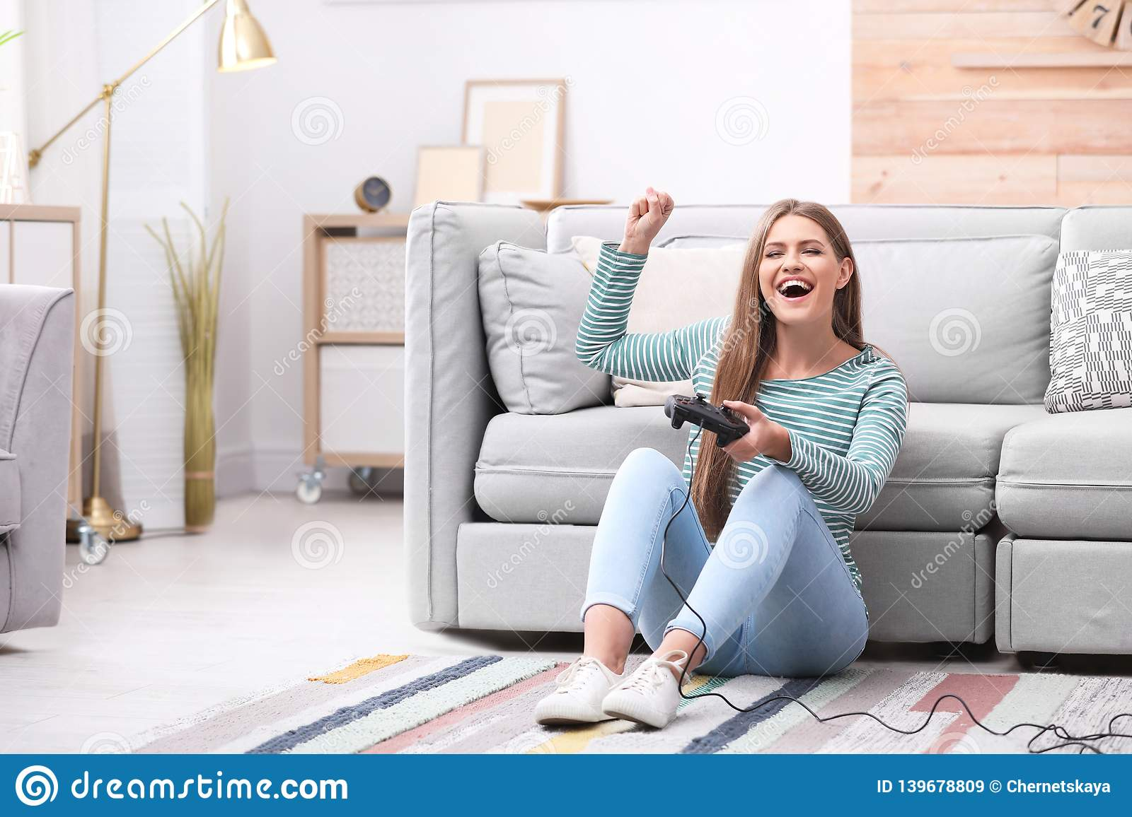 Emotional young woman playing video games
