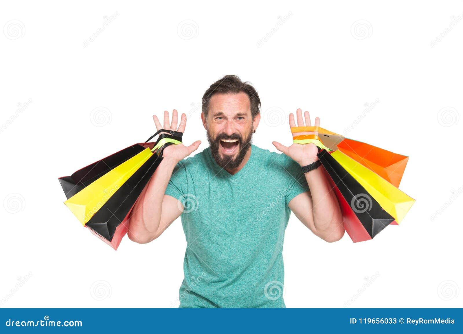 Emotionele verkooptijd Mensen gek over het winkelen Uiterst gelukkige mens met gekleurde het winkelen zak in handen op witte acht