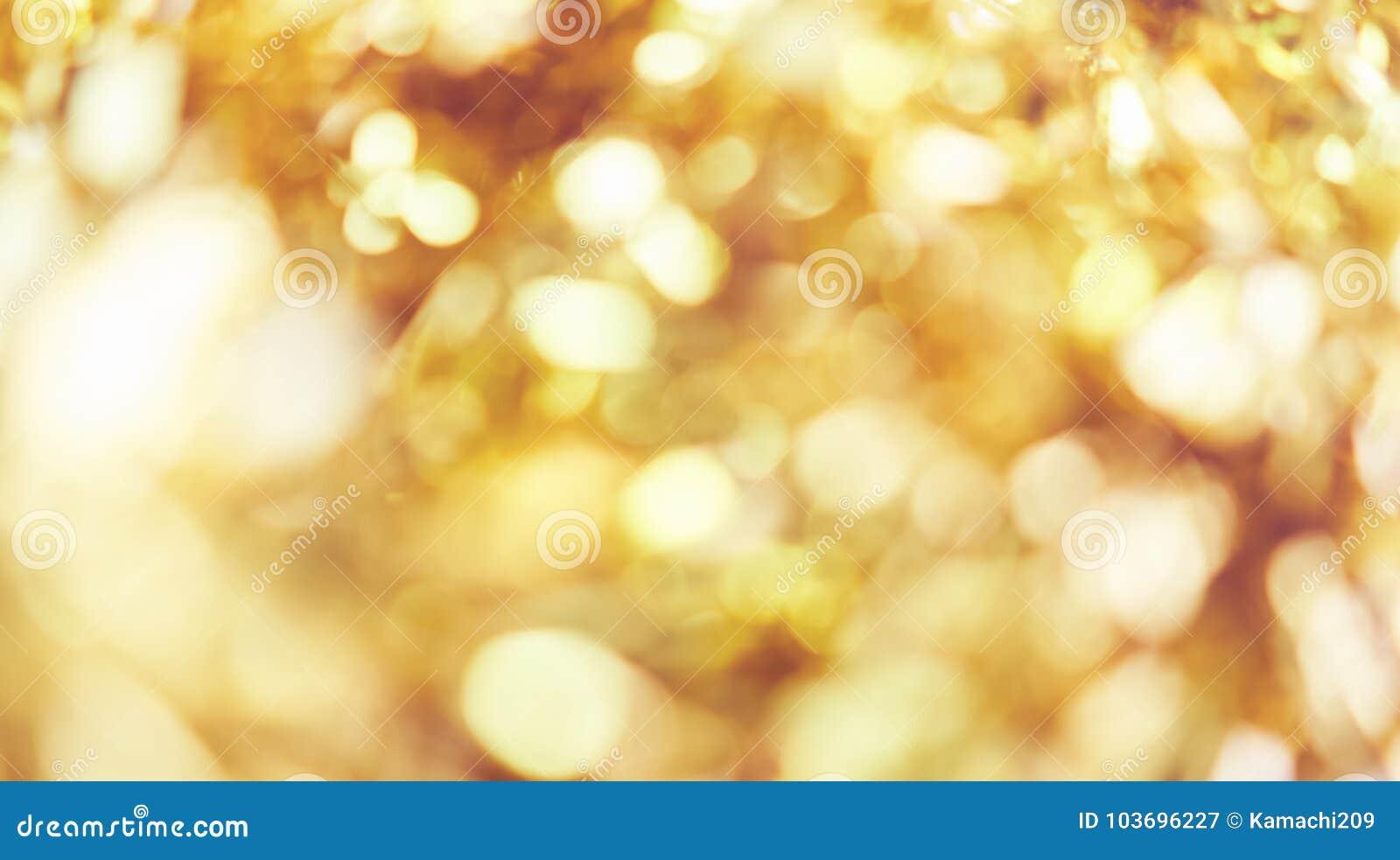 Empañe el fondo de la luz del bokeh del color oro, popular en el festival general Haga la imagen de lujo en su pedazo del trabajo