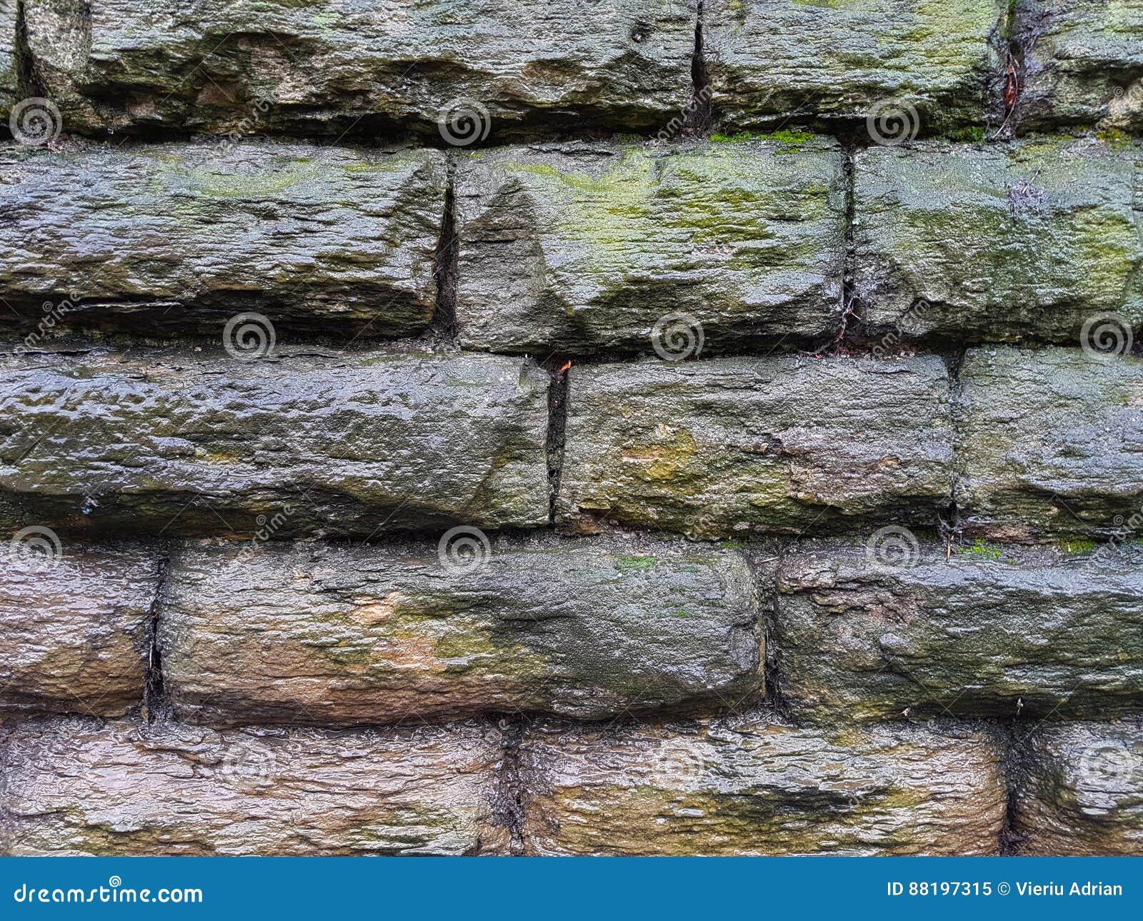 emparede el ladrillo construccin de piedra de la casa del extracto del papel pintado del