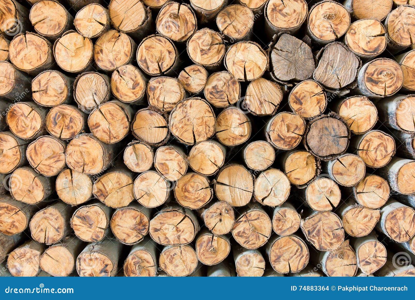 Empilhe o material de construção de madeira da madeira para o fundo e o textur