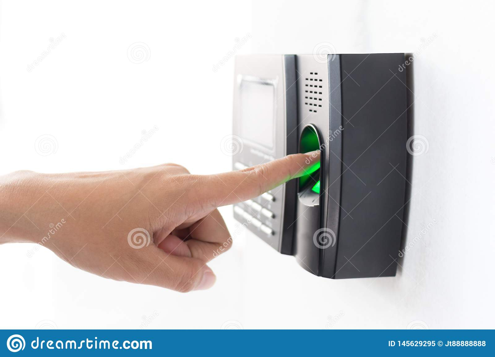 Employee scanning fingerprint to record working