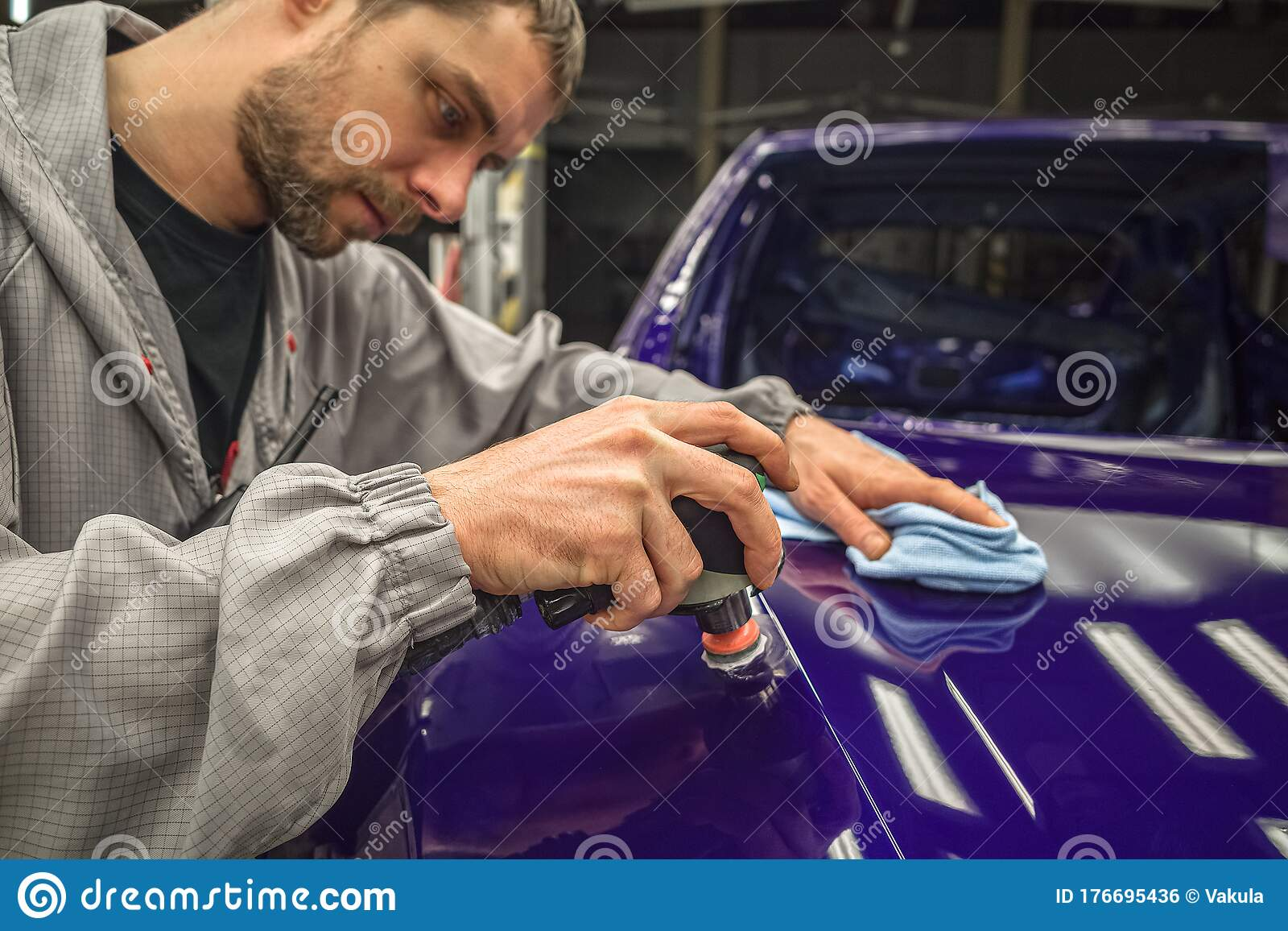 A Worker In The Painting Shop Of A Car Body Sanding Painted Items Stock Photo Image Of Color Painting 176695436