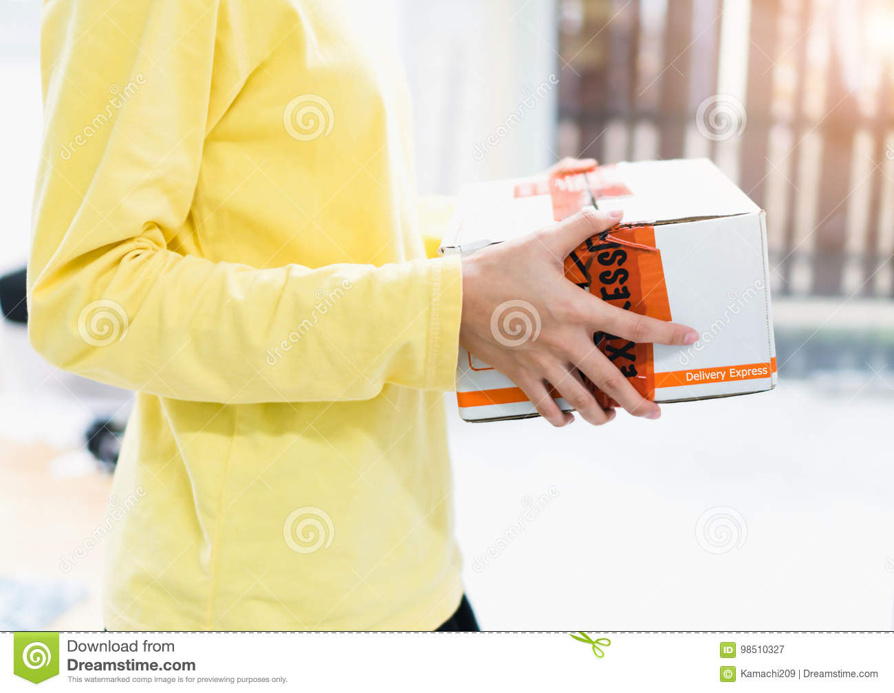 Employees hold parcel damaged before delivery to customer. The company is responsible for replacing it.