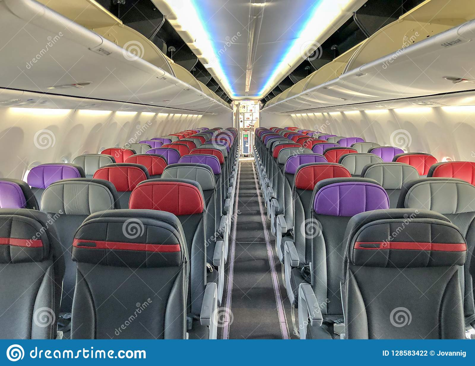 Empty airplane with seats and windows