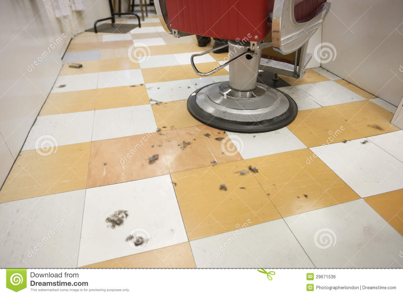 an empty barber shop with cut hair on floor royalty free stock