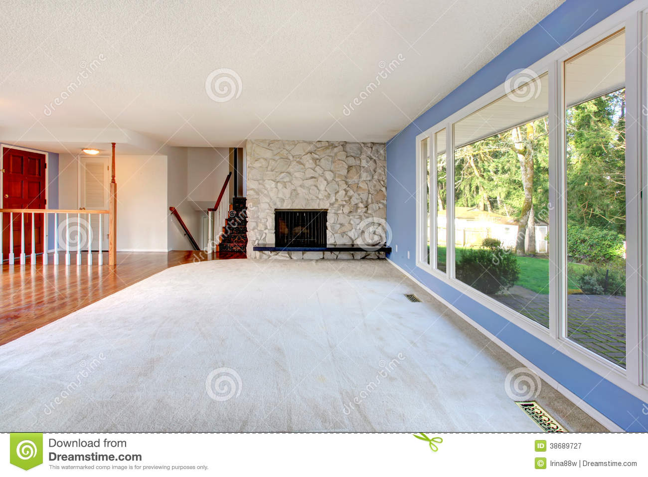 Big empty living room - Empty Beautiful Living Room With A Fireplace Royalty Free Stock Photography