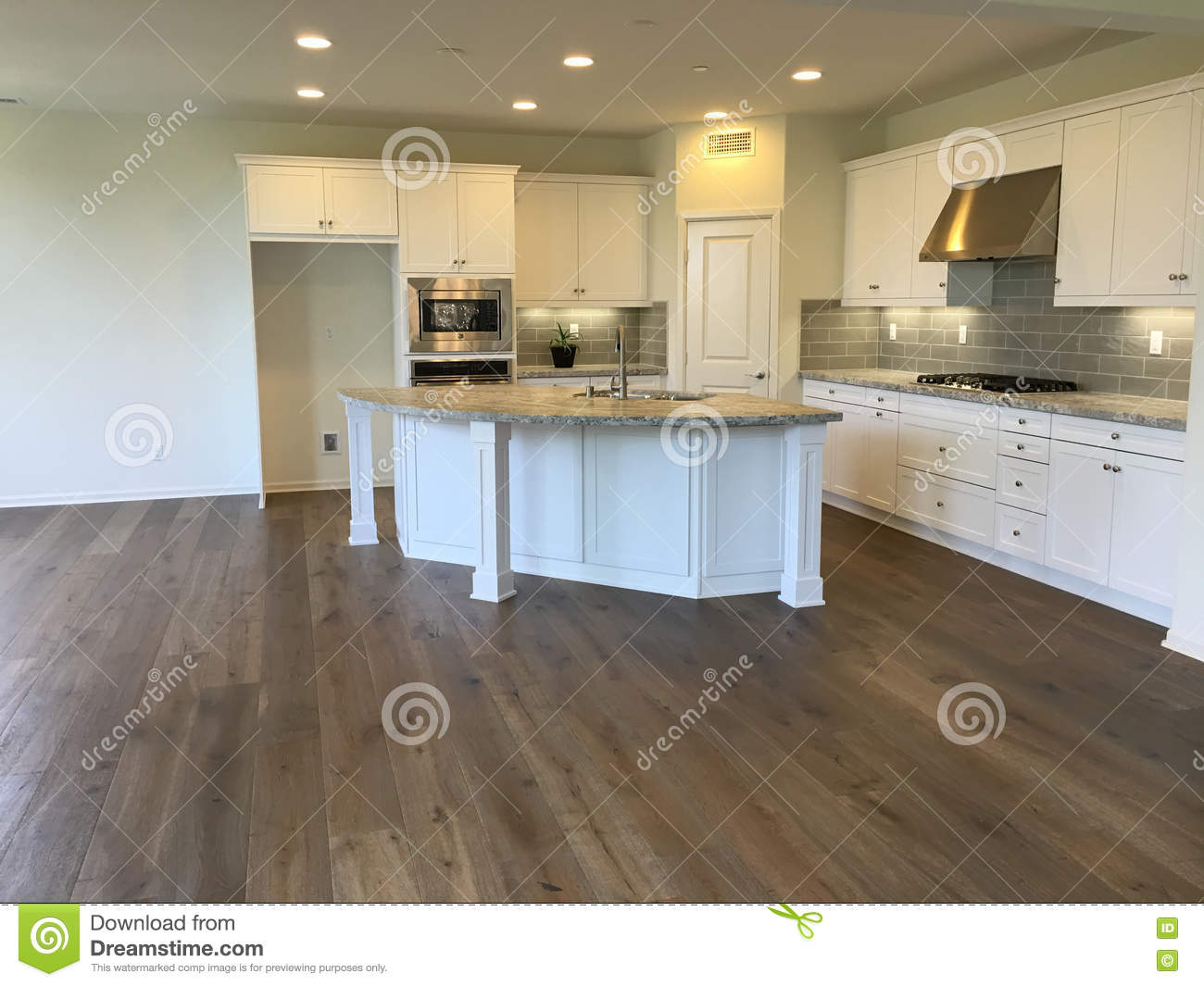 empty beautiful modern white kitchen with wood floors stock photo image 70635706. Black Bedroom Furniture Sets. Home Design Ideas
