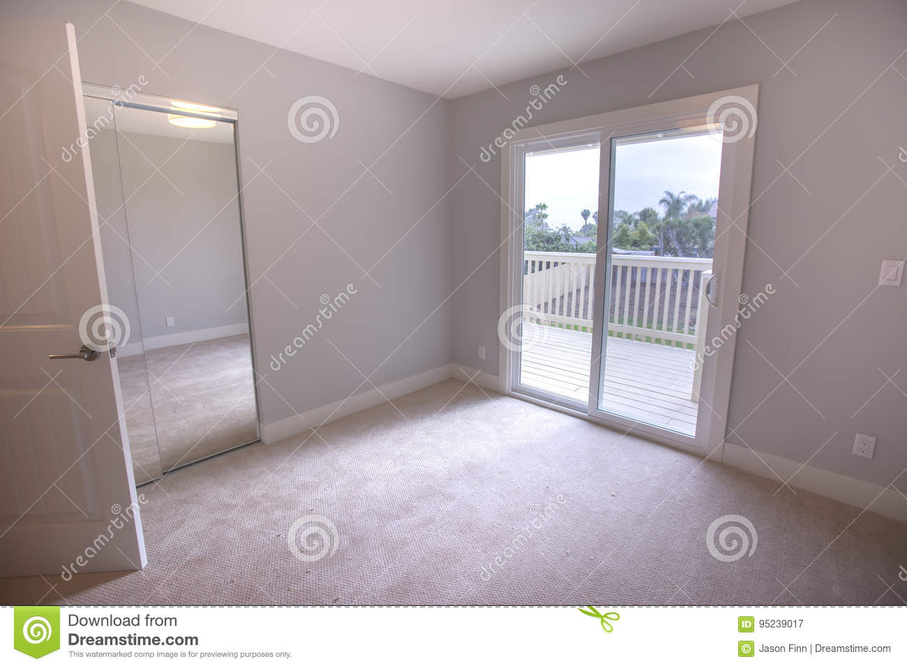 Empty Bedroom With Large Sliding Glass Door To The Deck Of The