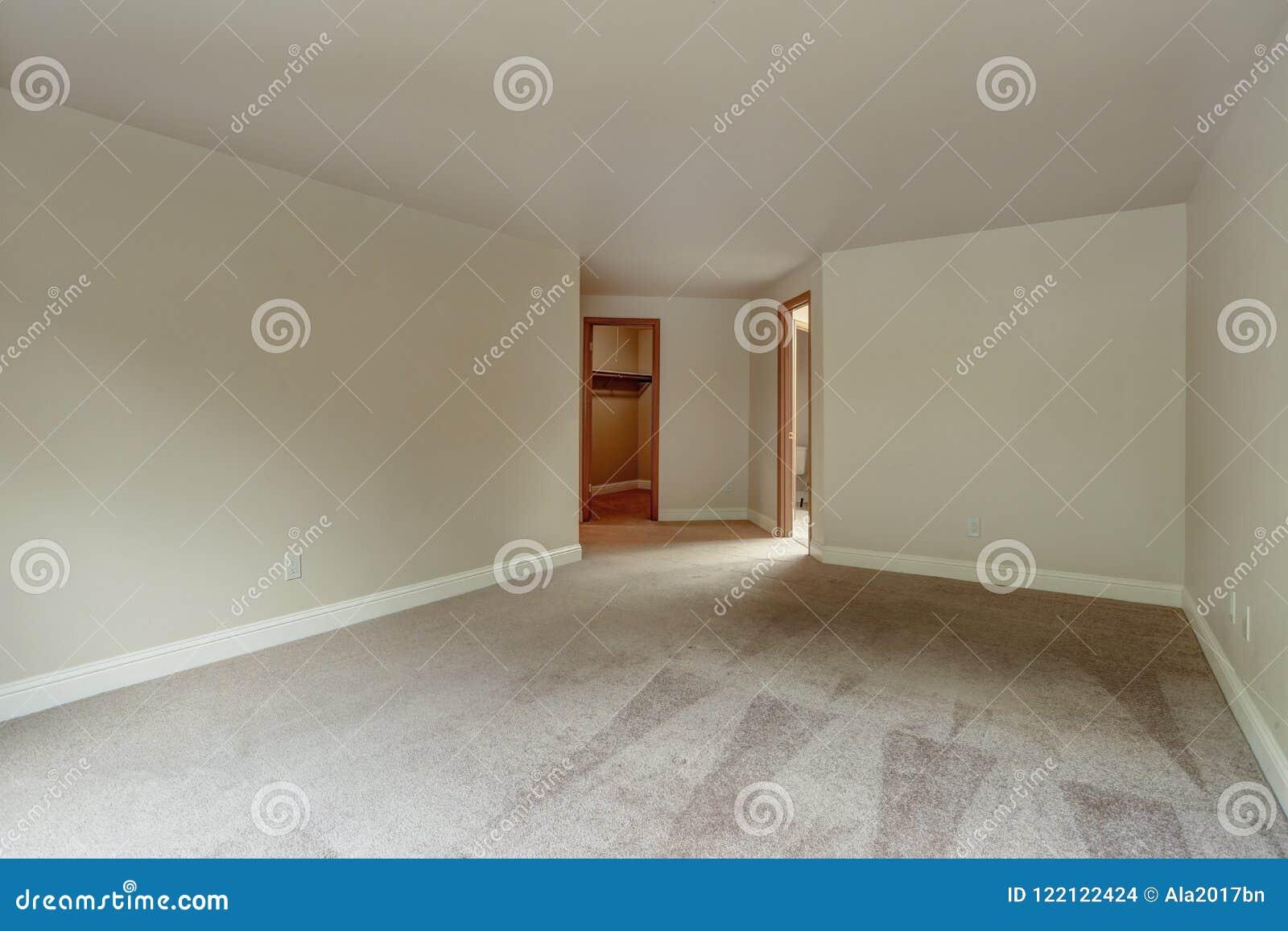 Empty bedroom with carpet floor.