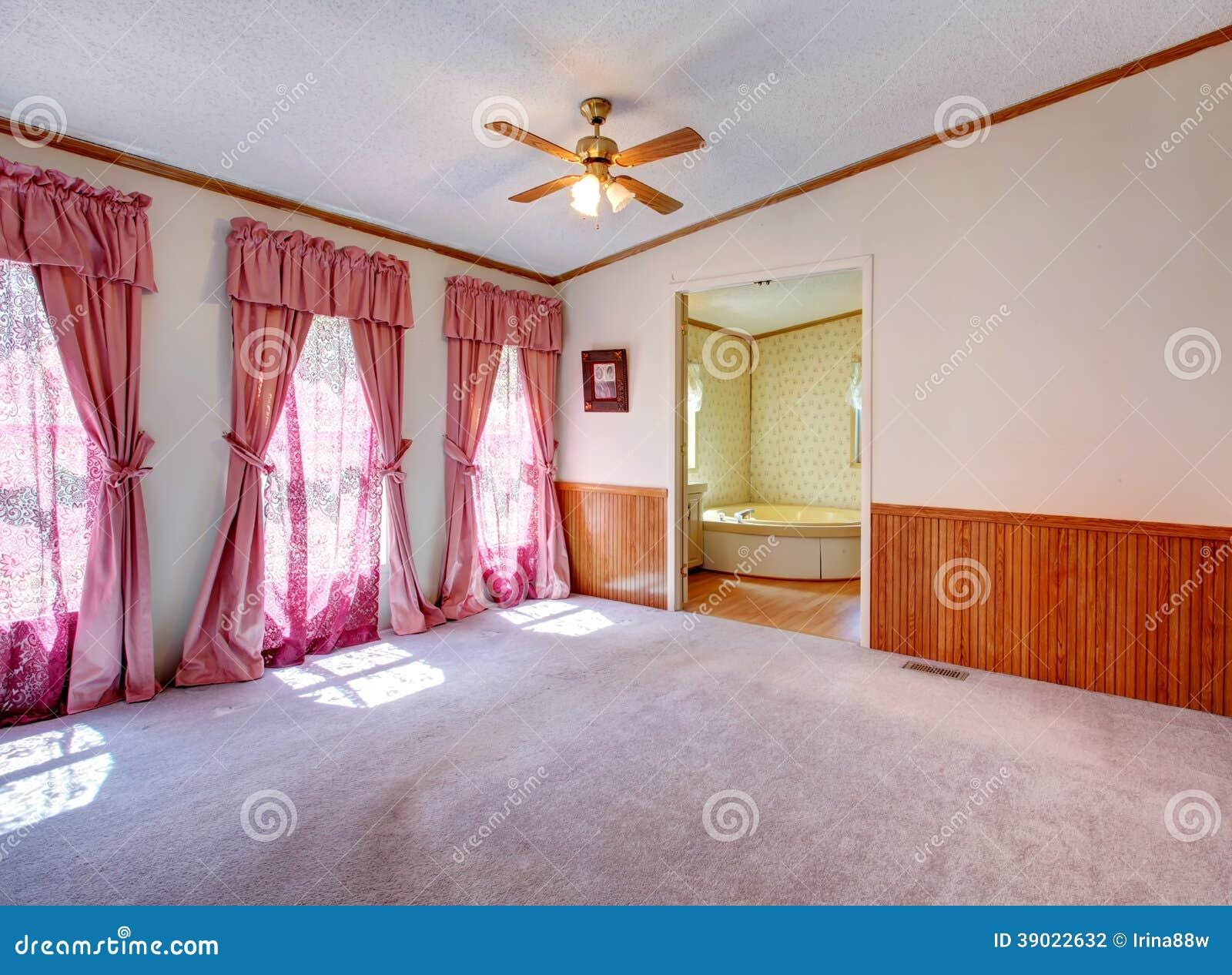 Empty bedroom with nice window treatment stock photo for Empty master bathroom