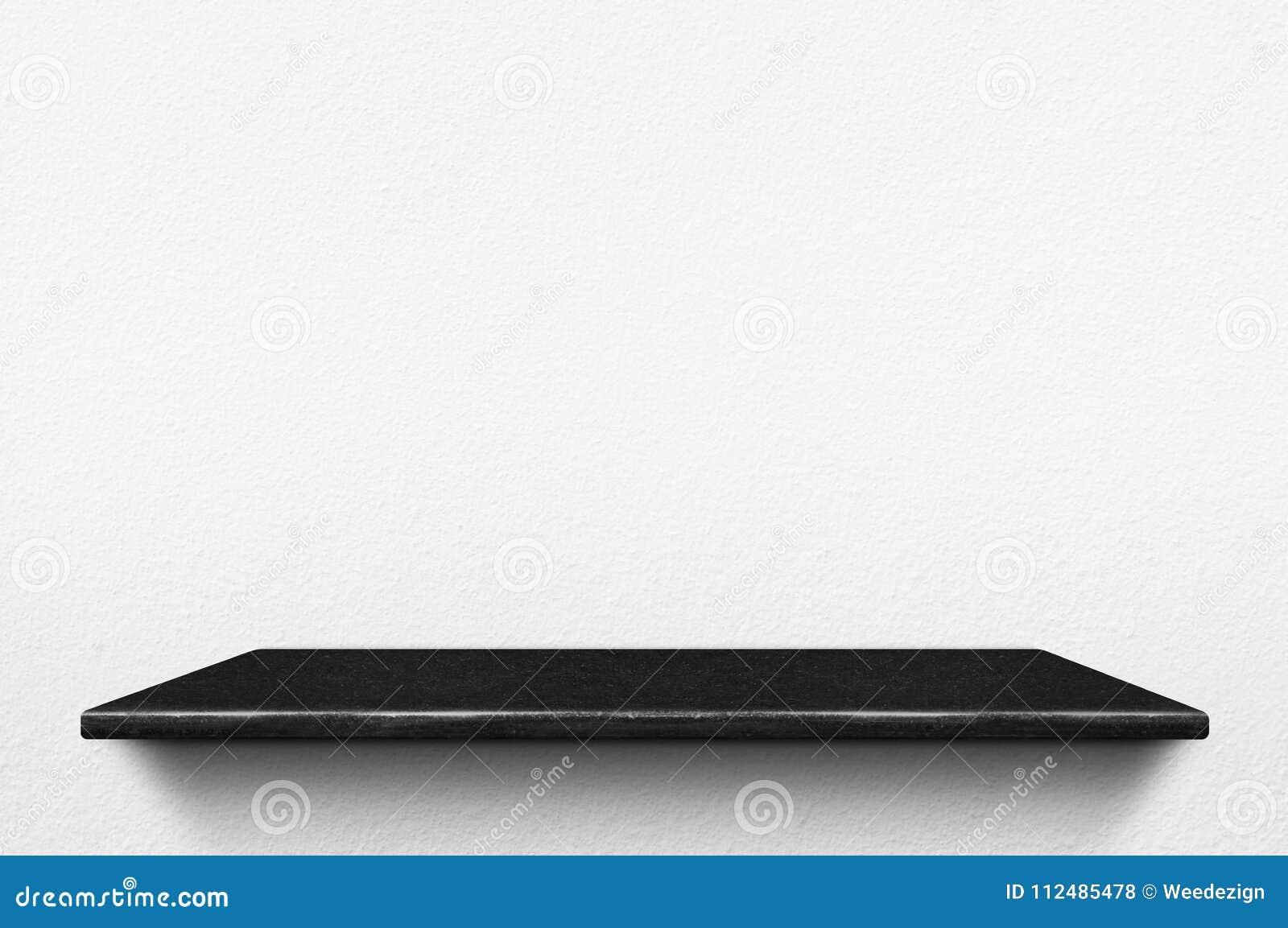 Empty Black Marble Stone Shelf At White Concrete Wall