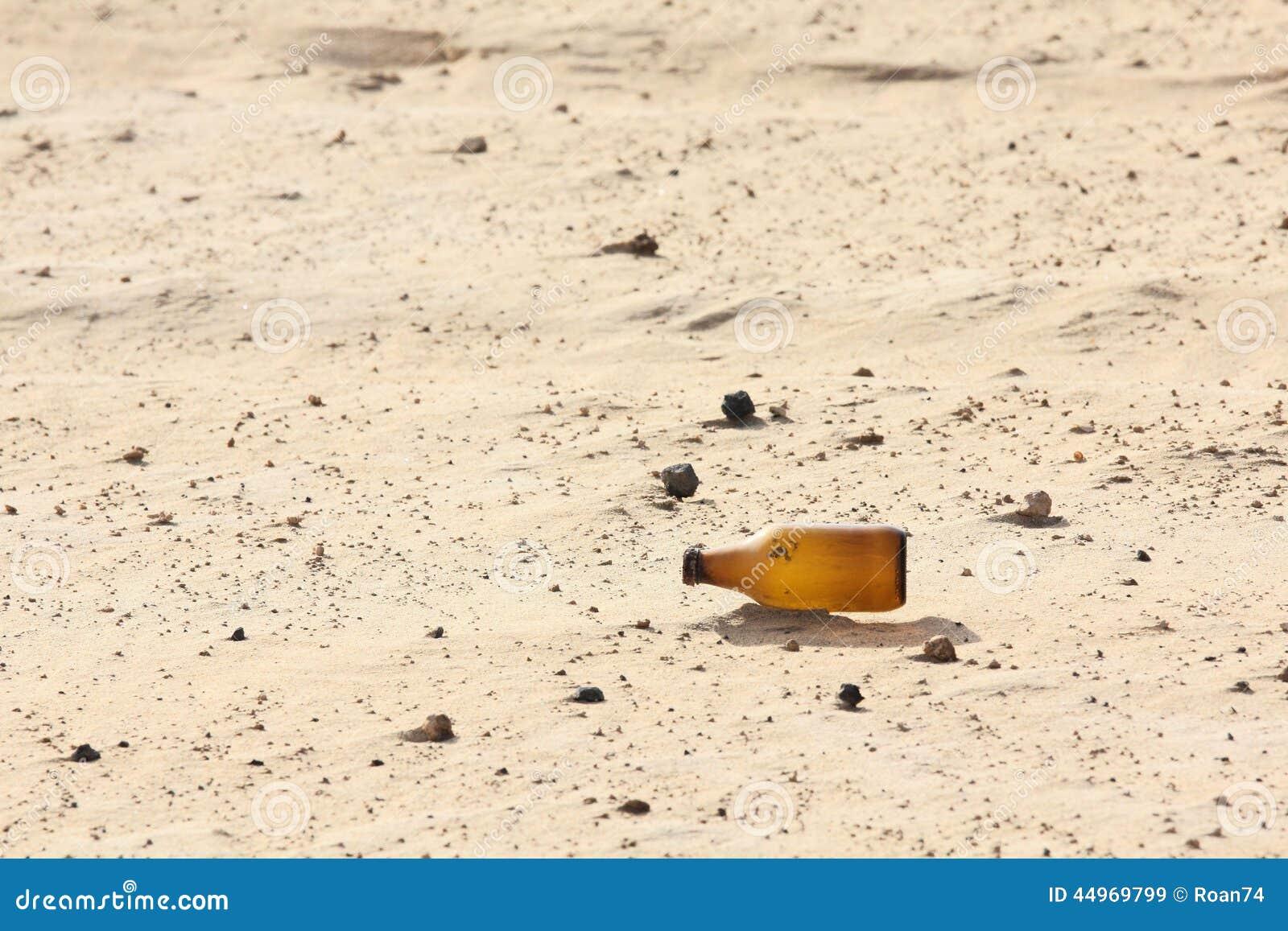 Empty Bottle In Desert Stock Photo - Image: 44969799