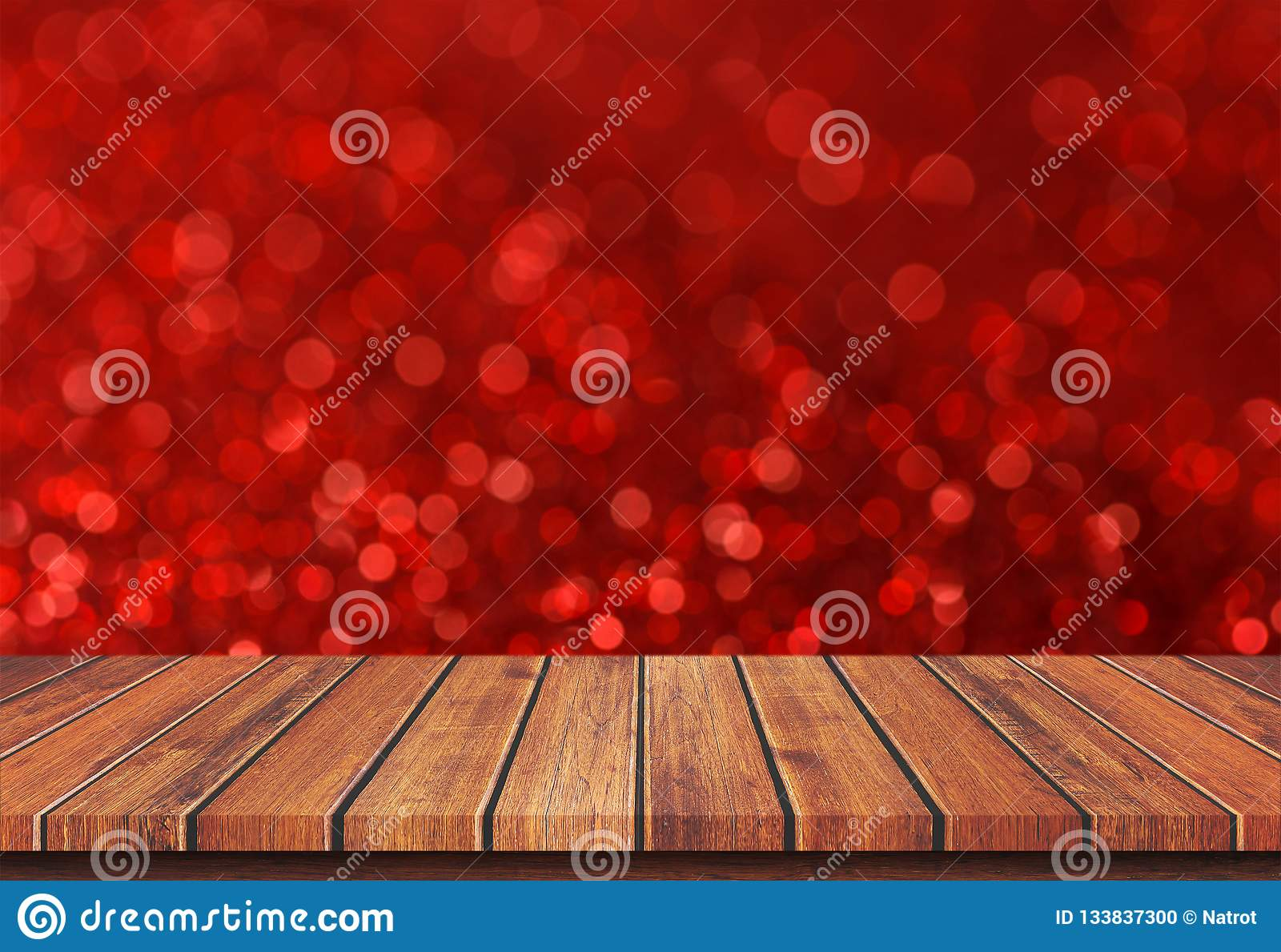 Empty brown wood table top on red blur bokeh light background