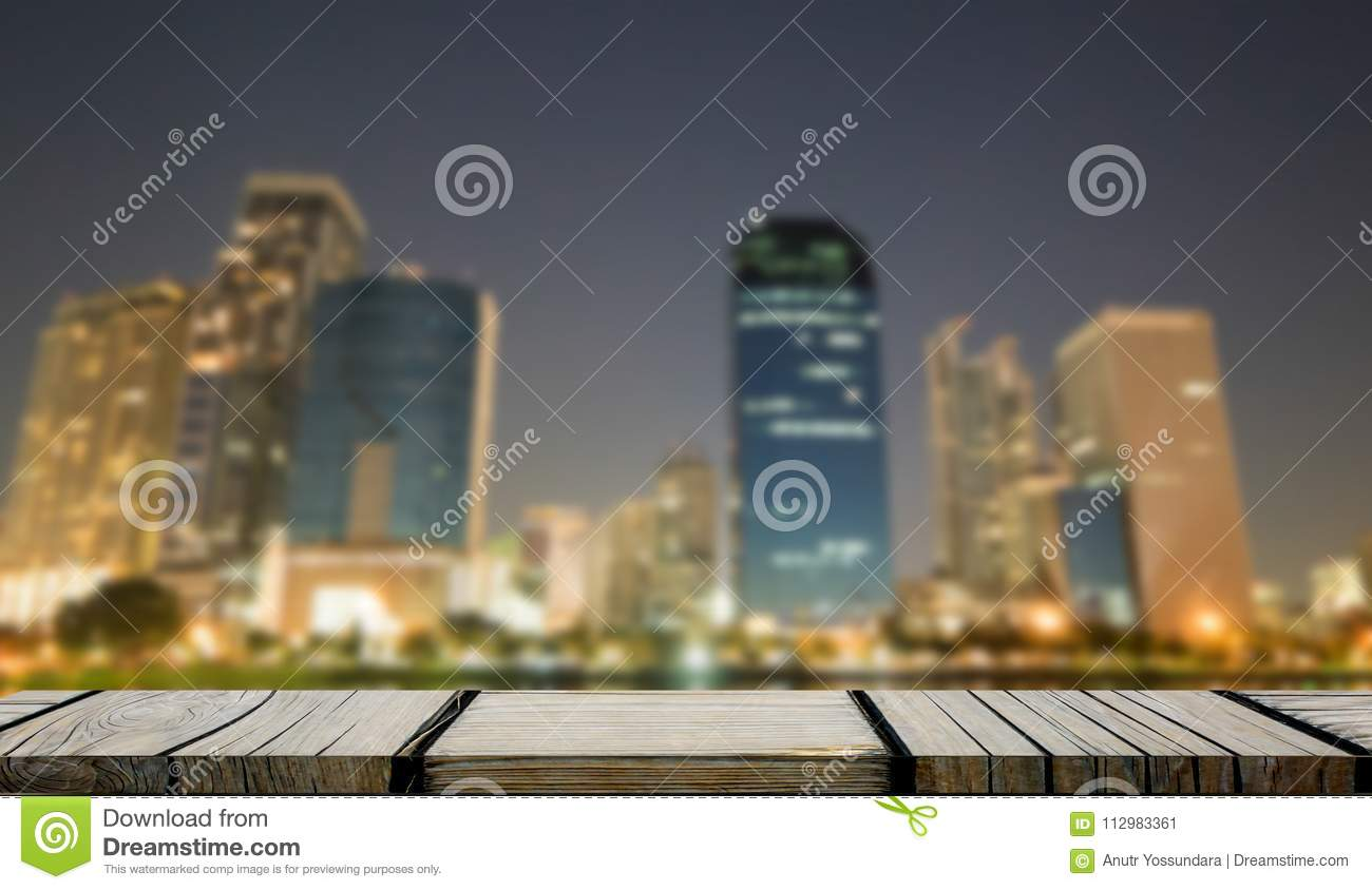 Empty brown wooden shelf with Bangkok City background