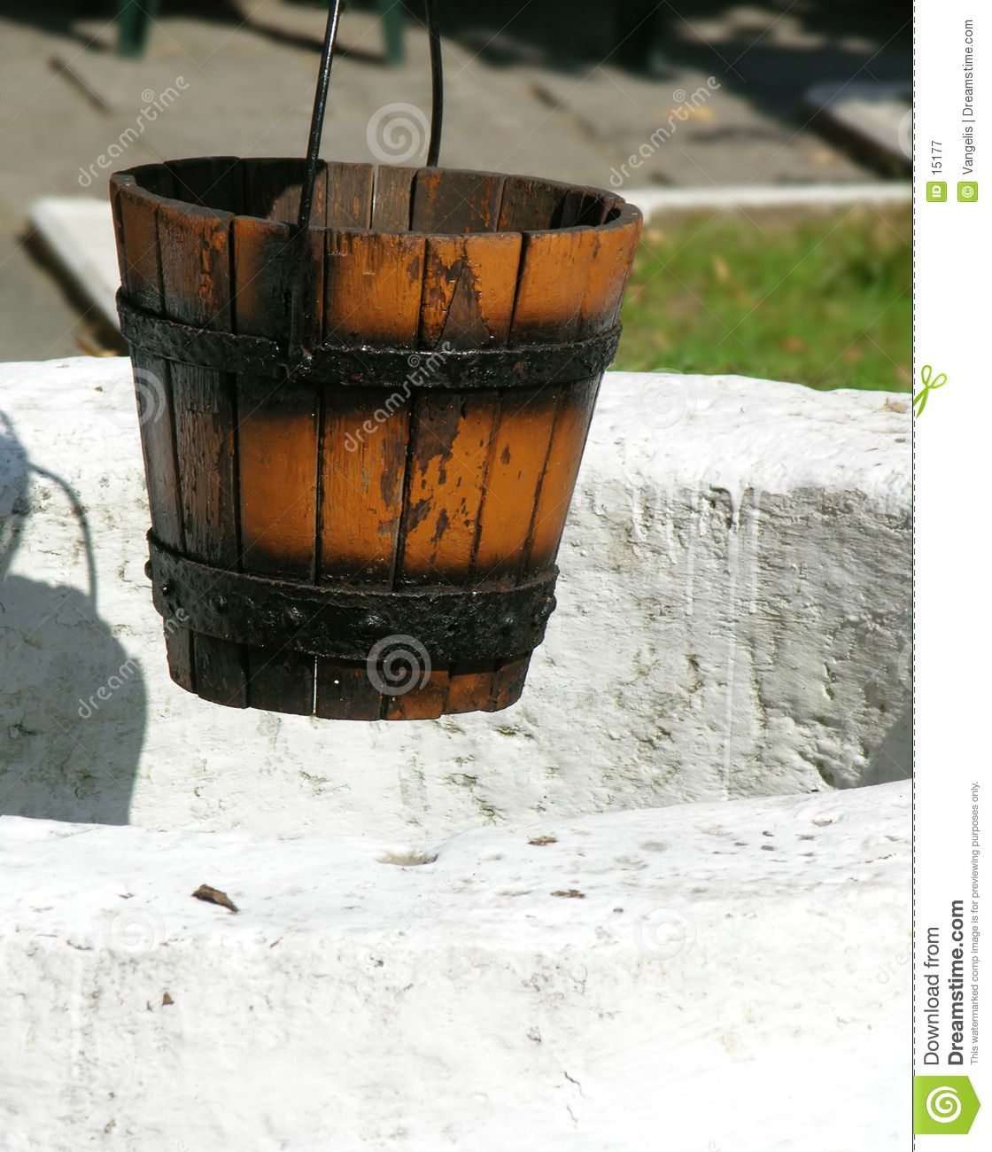 Empty Bucket Hanging Over An Ancient Well