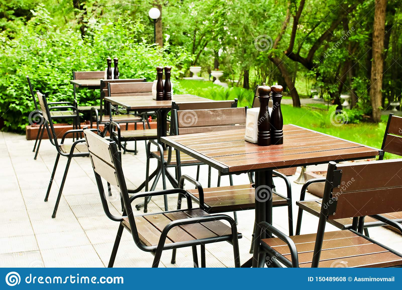 Excellent Empty Woode Tables And Chairs In The Outdoor Cafe Ready For Short Links Chair Design For Home Short Linksinfo