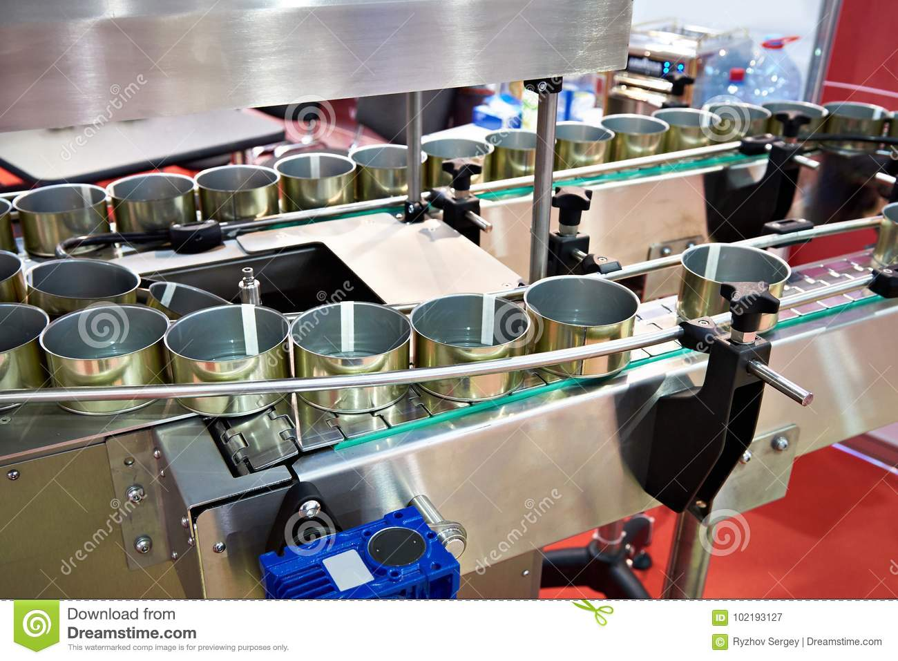 Empty cans on conveyor of food factory