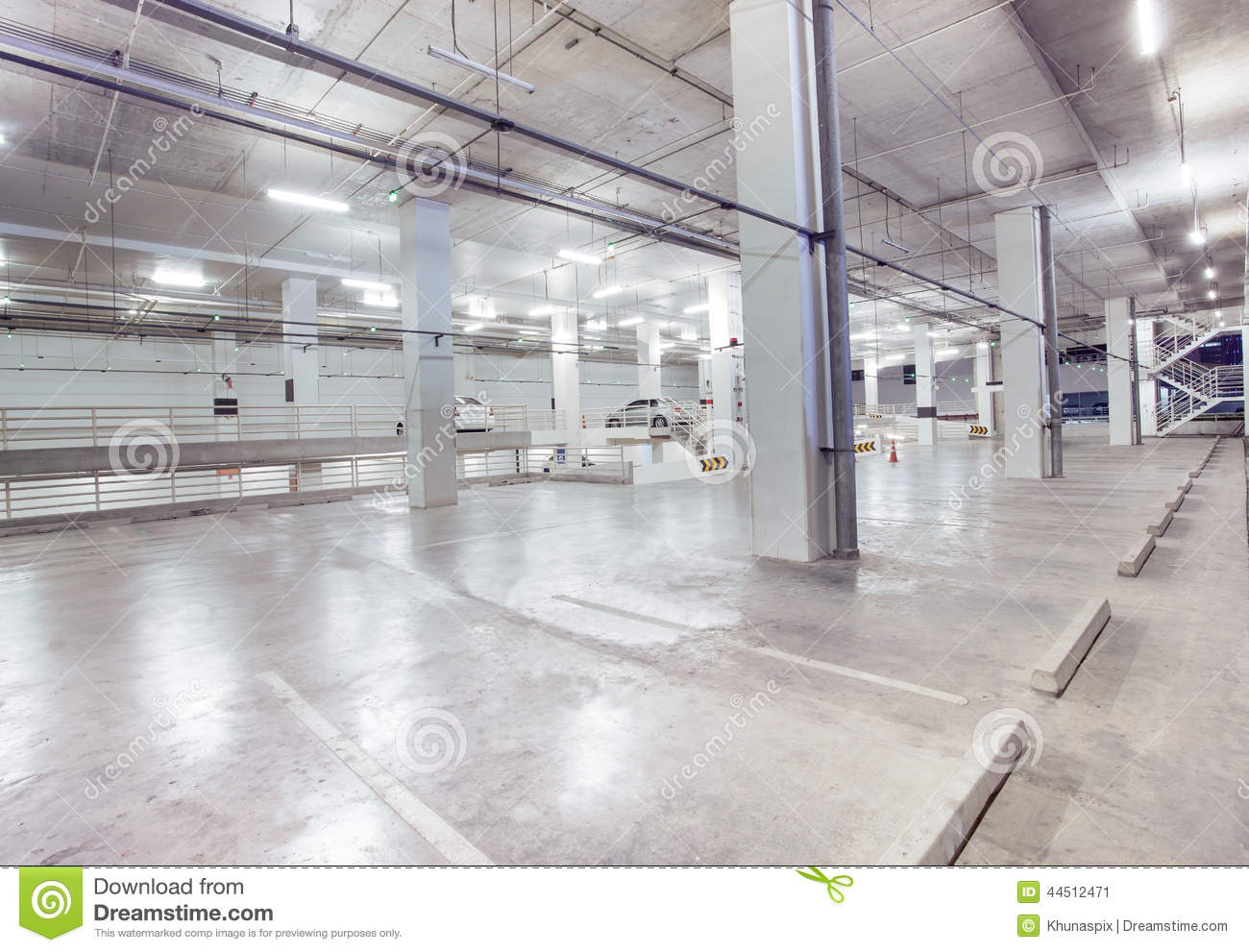 Empty car parking lot in modern building design with for Modern design building services