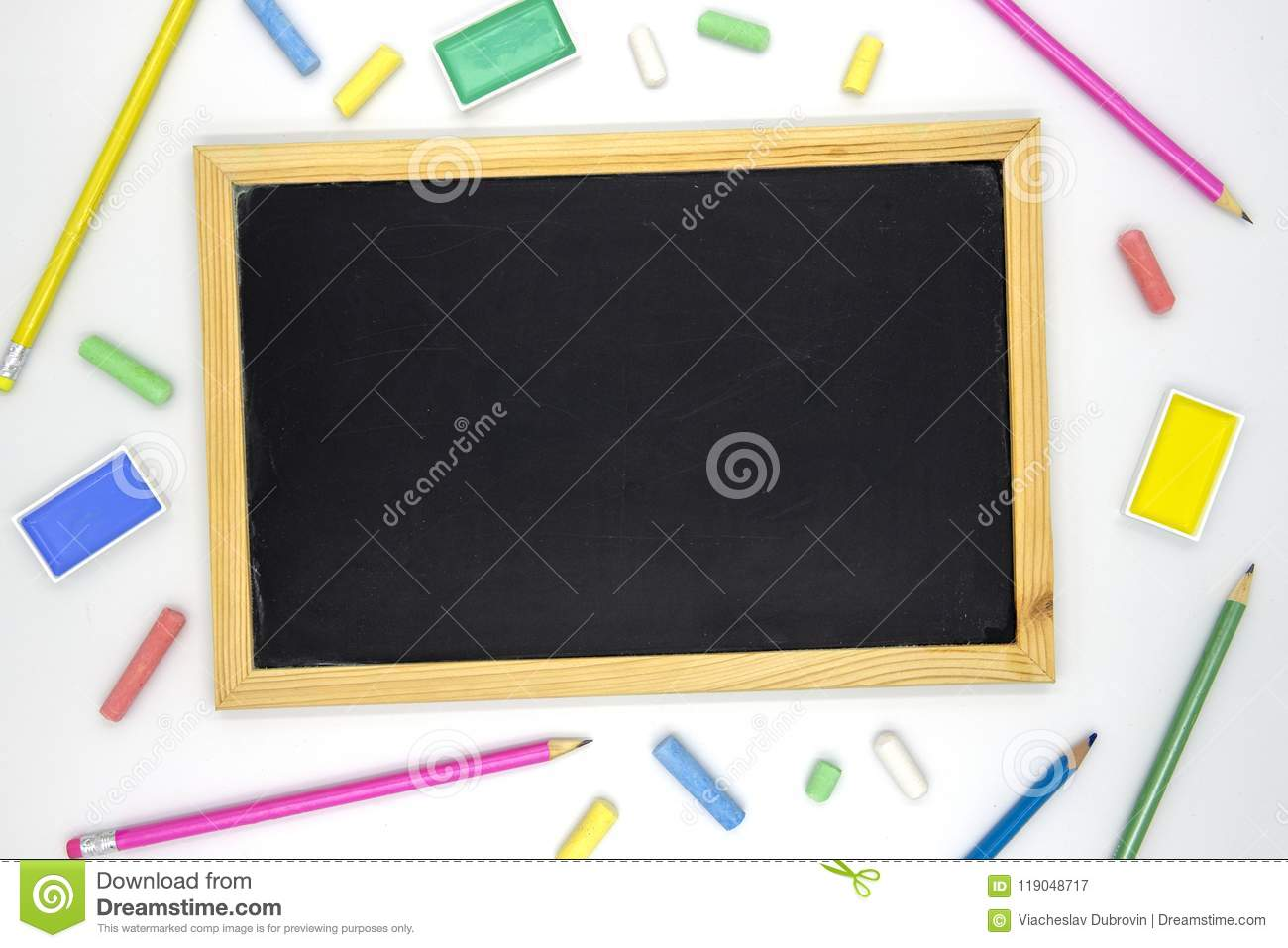 empty chalkboard with art supplies on white background blackboard