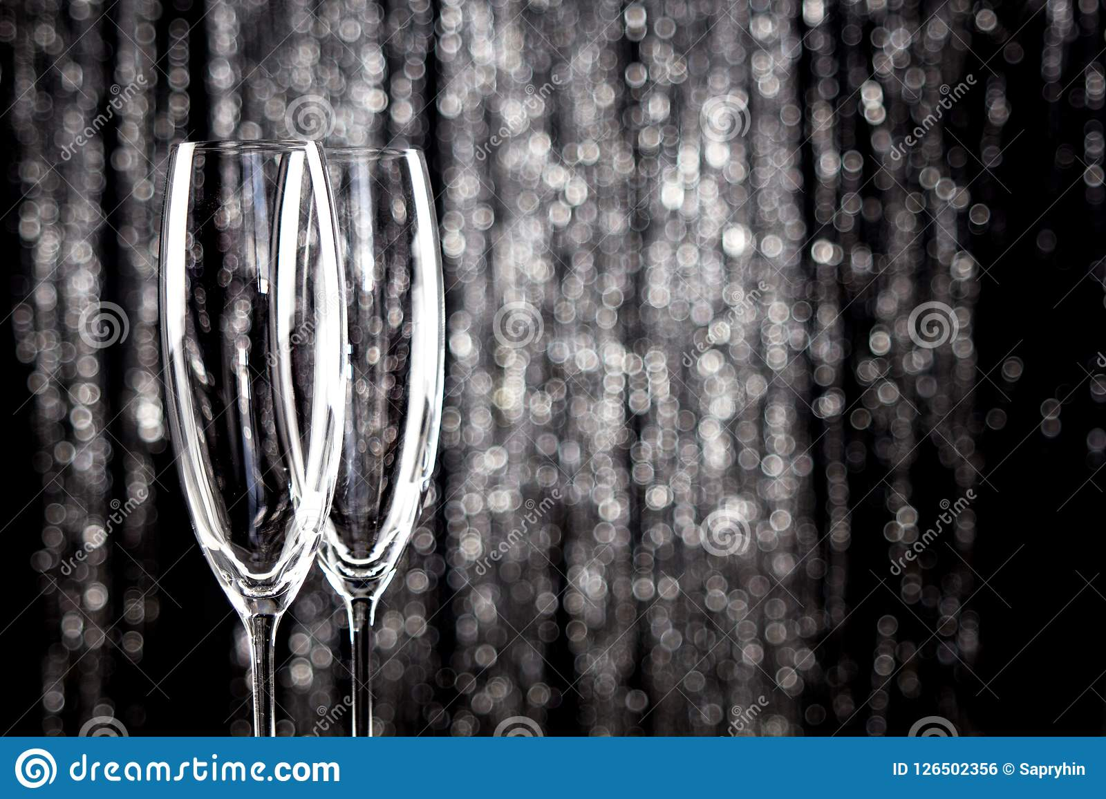 Empty Champagne Or Wine Glasses With Glitter Christmas Tinsel