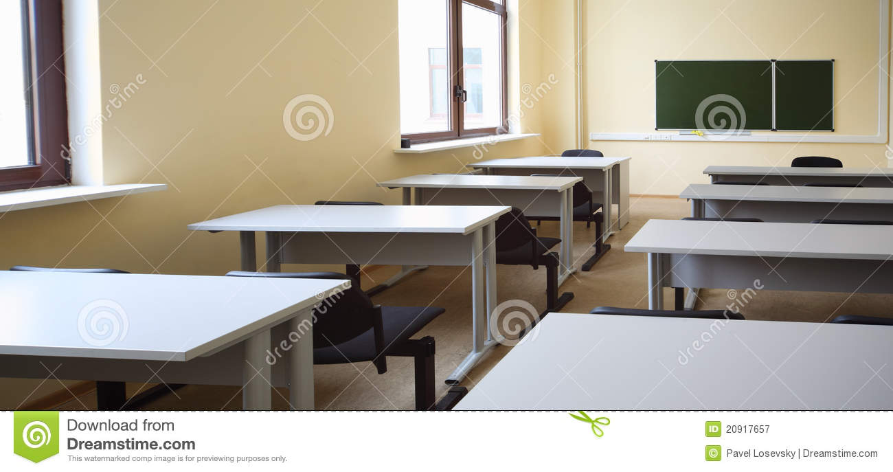 Empty Classroom With School Desks And Black Chairs Royalty