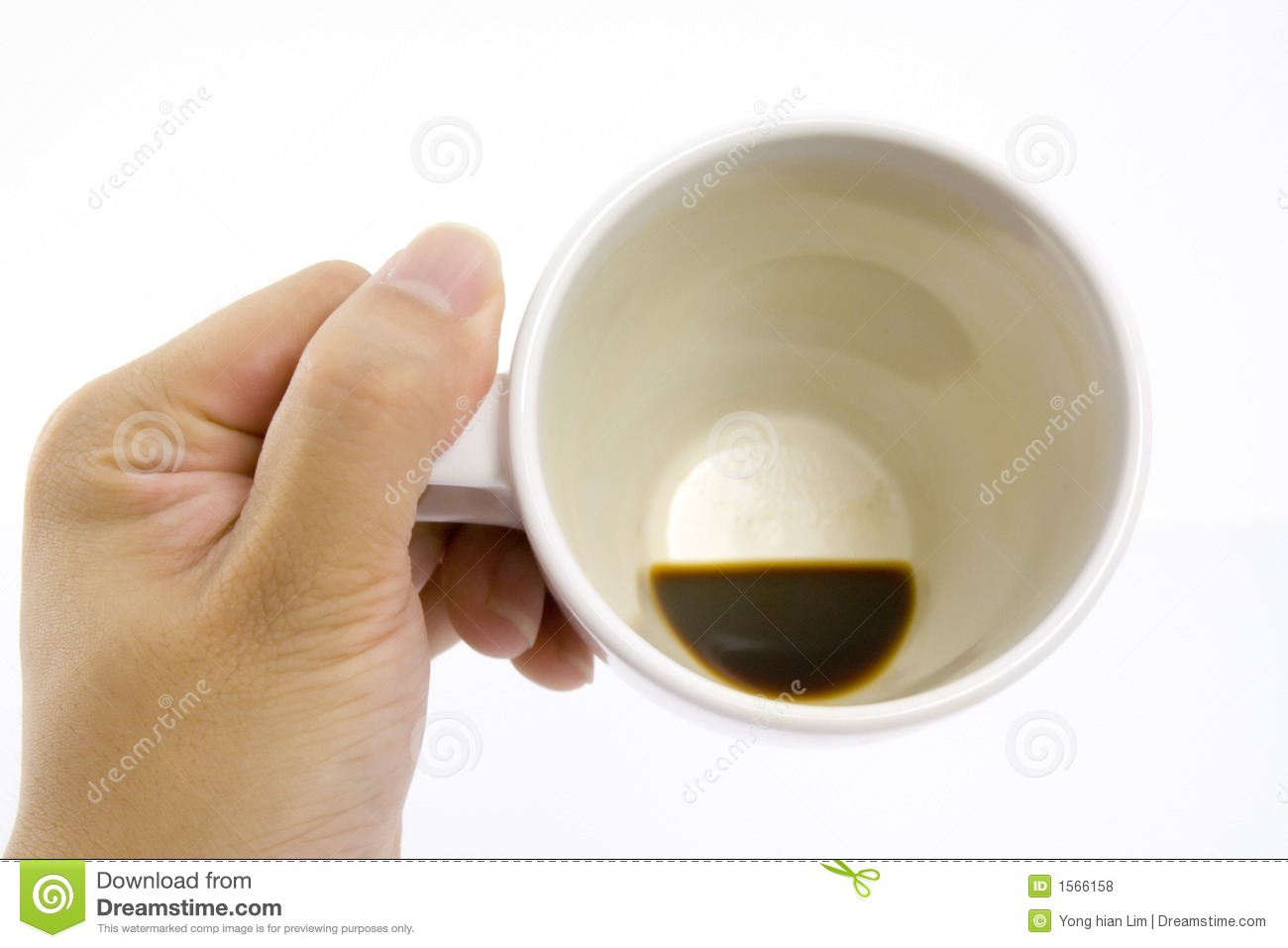 Hand holding an empty coffee cup isolated on white background.