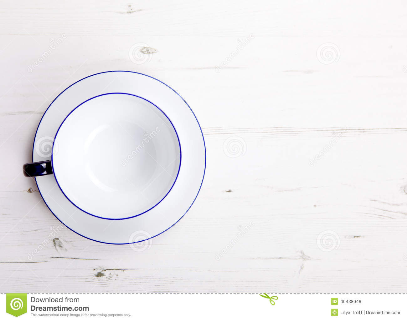 Empty Cup Top : Empty cup and saucer on a white wooden table view from
