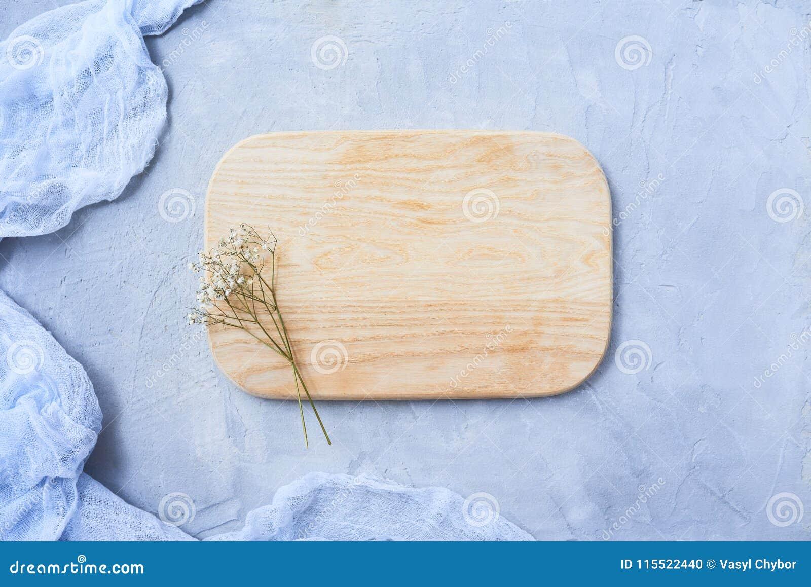 Cutting board on rustic background