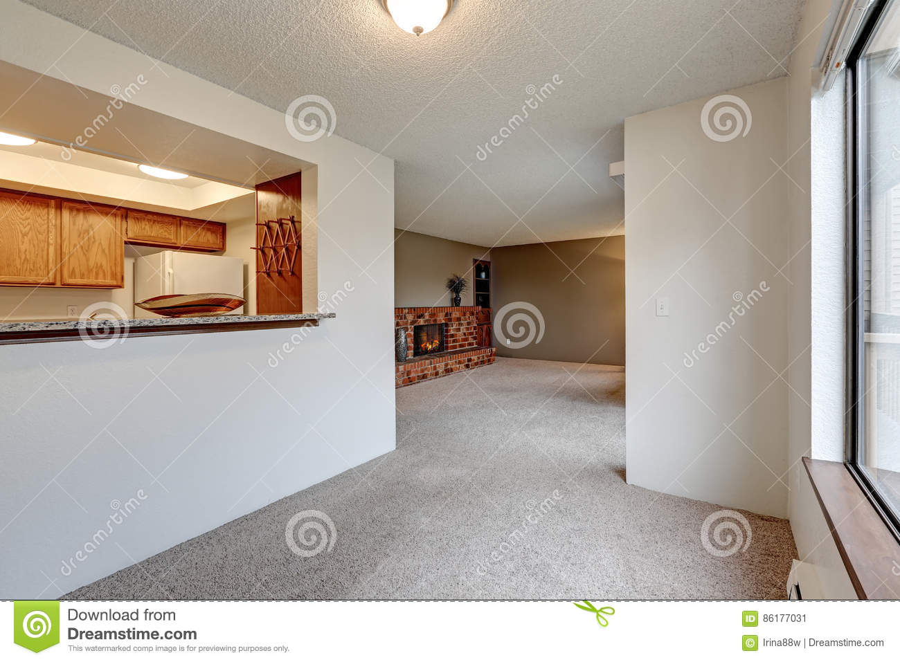 Empty Dining Room With White Walls And Wall To Carpet Next Kitchen View Of Living Brick Fireplace Northwest USA