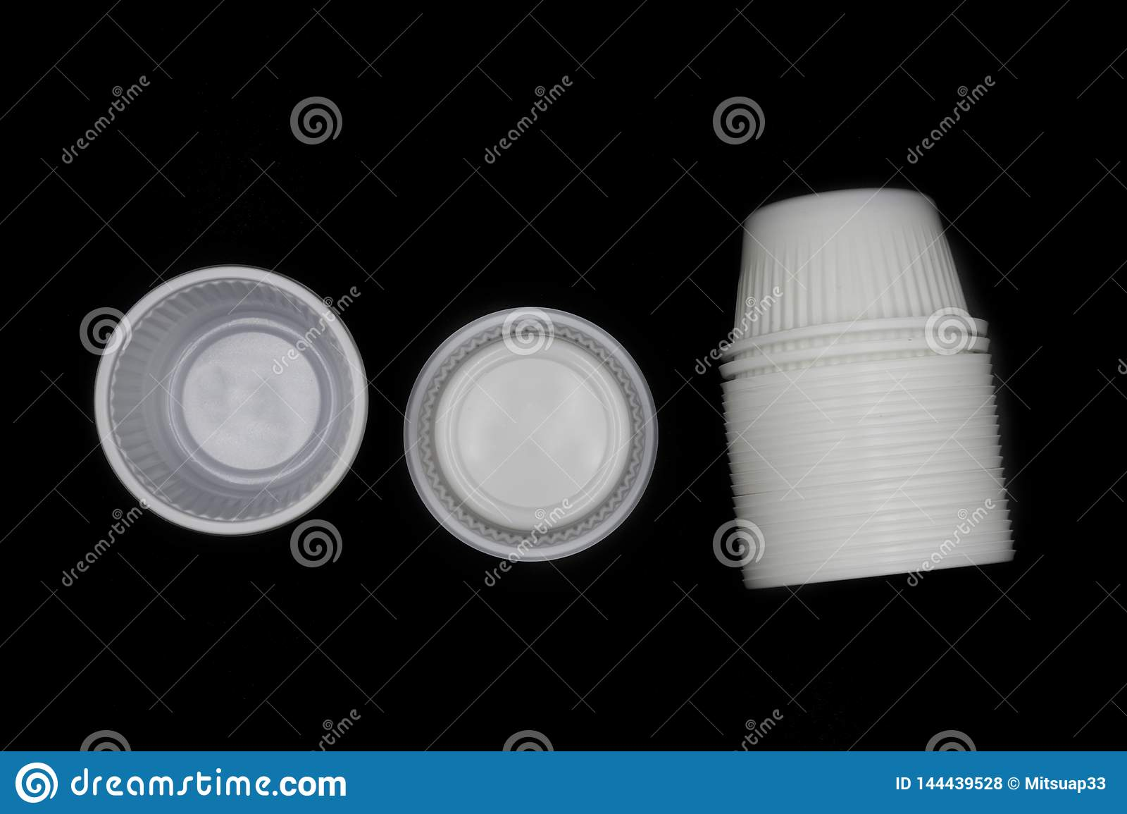 Empty Disposable Plastic Cup, Lying horizontally plastic cup isolated on black background