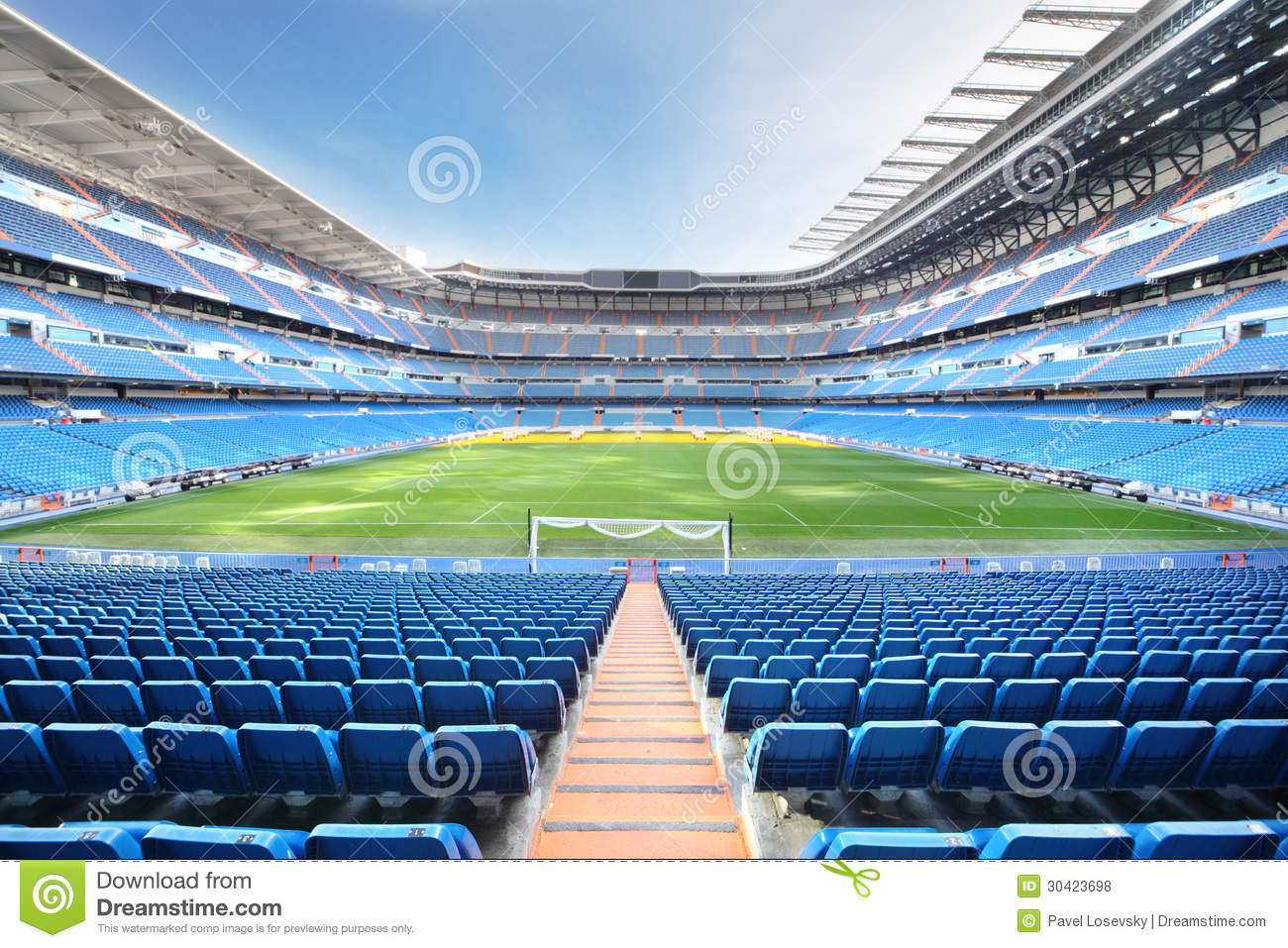 Empty Football Stadium With Seats Rolled Gates And Lawn