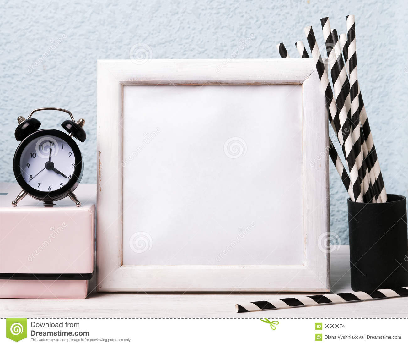 empty frame clock and paper straws