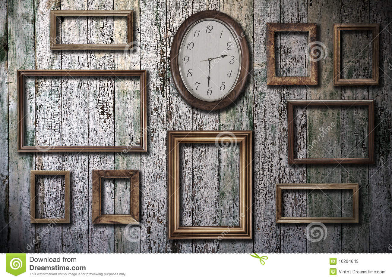 empty frames and watch on wooden wall