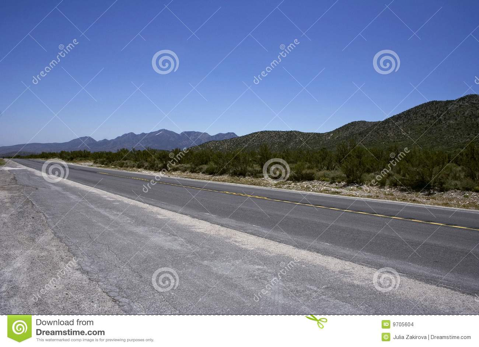 Empty freeway with the yellow stripe