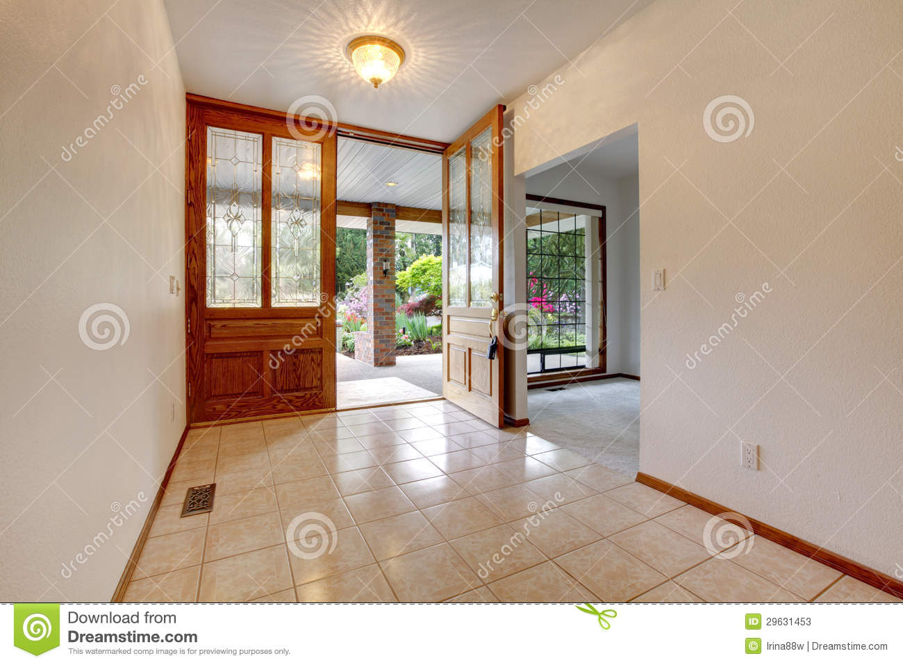 Empty front entrance with open door home interior stock for Porte maison interieur moderne