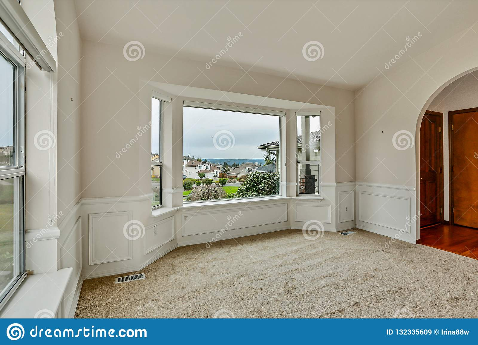 Empty front office room with large windows and arches
